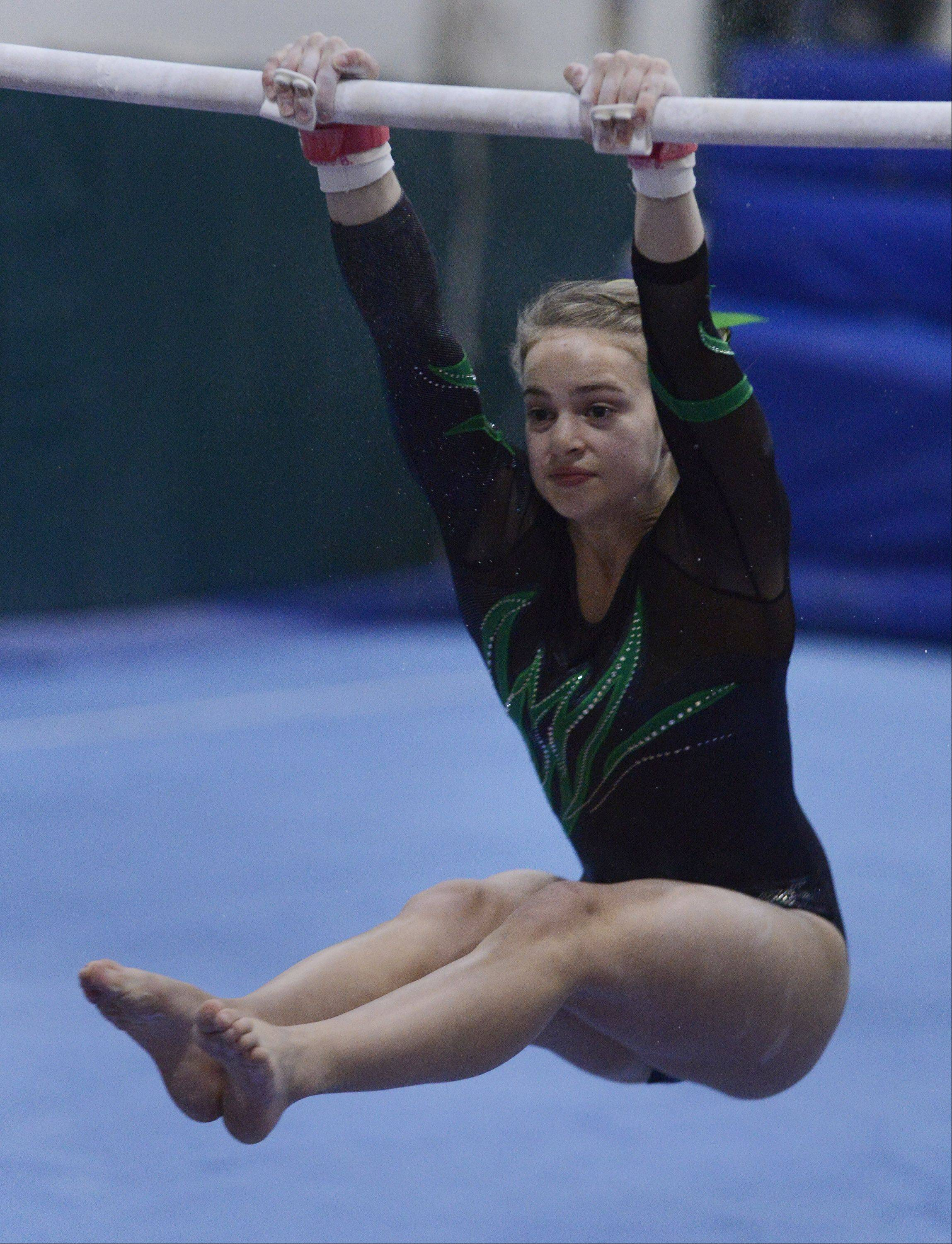 Fremd's Maggie Betti competes on the uneven parallel bars during Wednesday's meet with Buffalo Grove and Hersey.