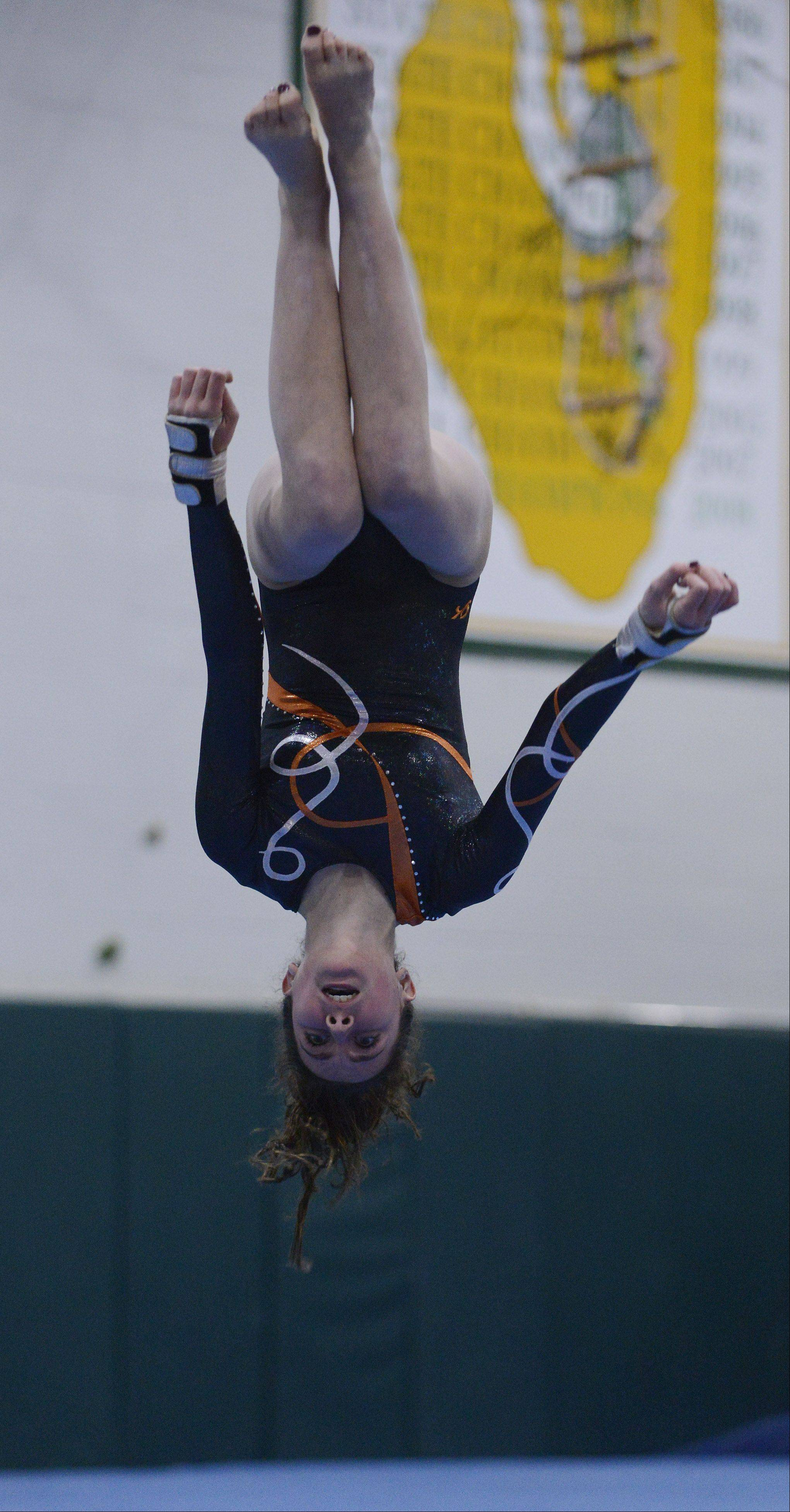 Hersey's Margaret Barton competes on the floor exercise during Wednesday's meet with Buffalo Grove and Fremd.