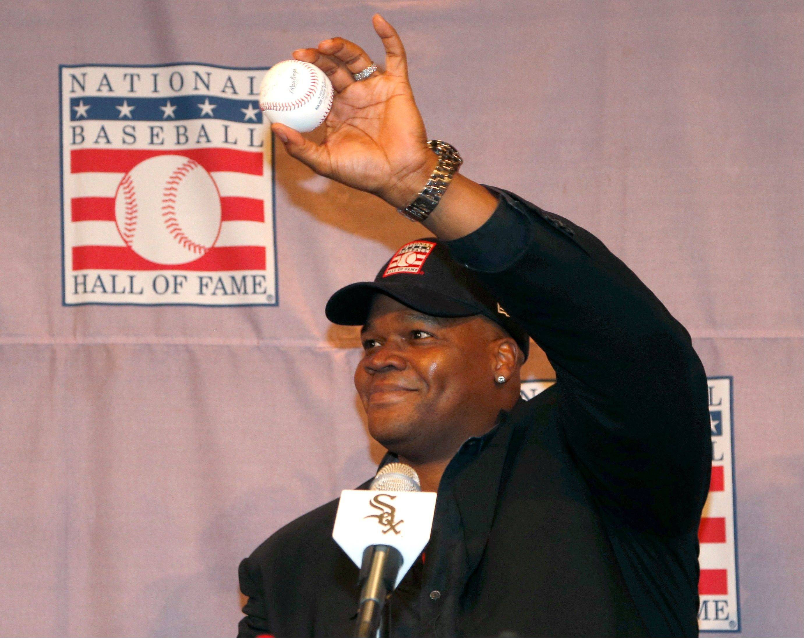 Frank Thomas holds up a baseball he signed 'Frank Thomas HOF' during a news conference about his selection into the Baseball Hall Of Fame on Wednesday at U.S. Cellular Field.