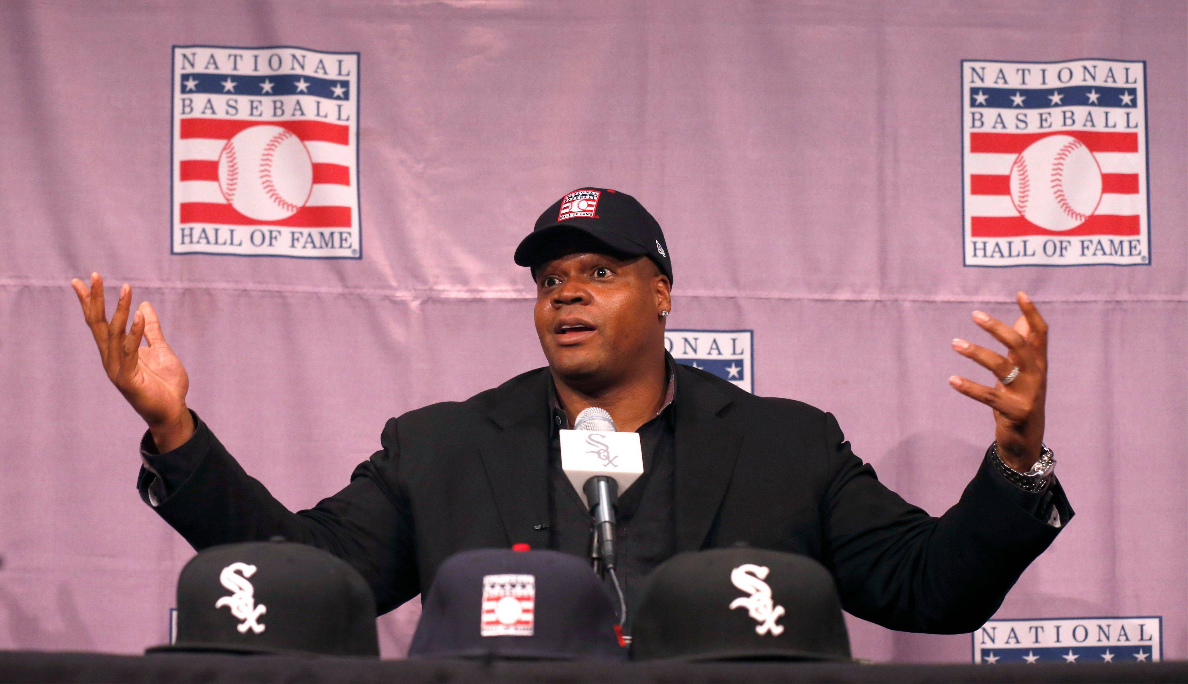 White Sox slugger Frank Thomas gestures during a news conference about his selection into the MLB Baseball Hall Of Fame Wednesday, Jan. 8, 2014, at U.S. Cellular Field in Chicago. Thomas joins Greg Maddux and Tom Glavine as first ballot inductees Wednesday, and will be inducted in Cooperstown on July 27 along with managers Bobby Cox, Joe Torre and Tony La Russa, elected last month by the expansion-era committee.