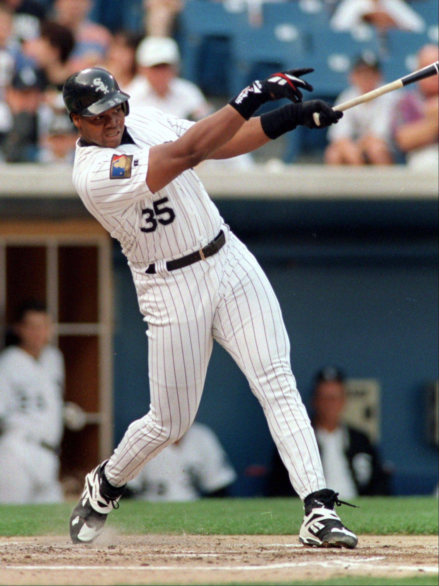 In this July 30, 1994 file photo, Chicago White Sox's Frank Thomas follows through on a home run against the Seattle Mariners in Chicago. Thomas is among three high-profile players on the baseball Hall of Fame ballot for the first time. The votes will be announced Wednesday, Jan. 8, 2014.