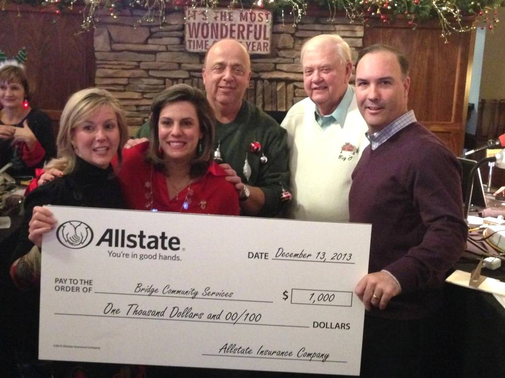 Allstate agency owner, Casey Mulcare (pictured, far right), presents a $1000 donation to Bridge Community Services at The Ivy in Wheaton.