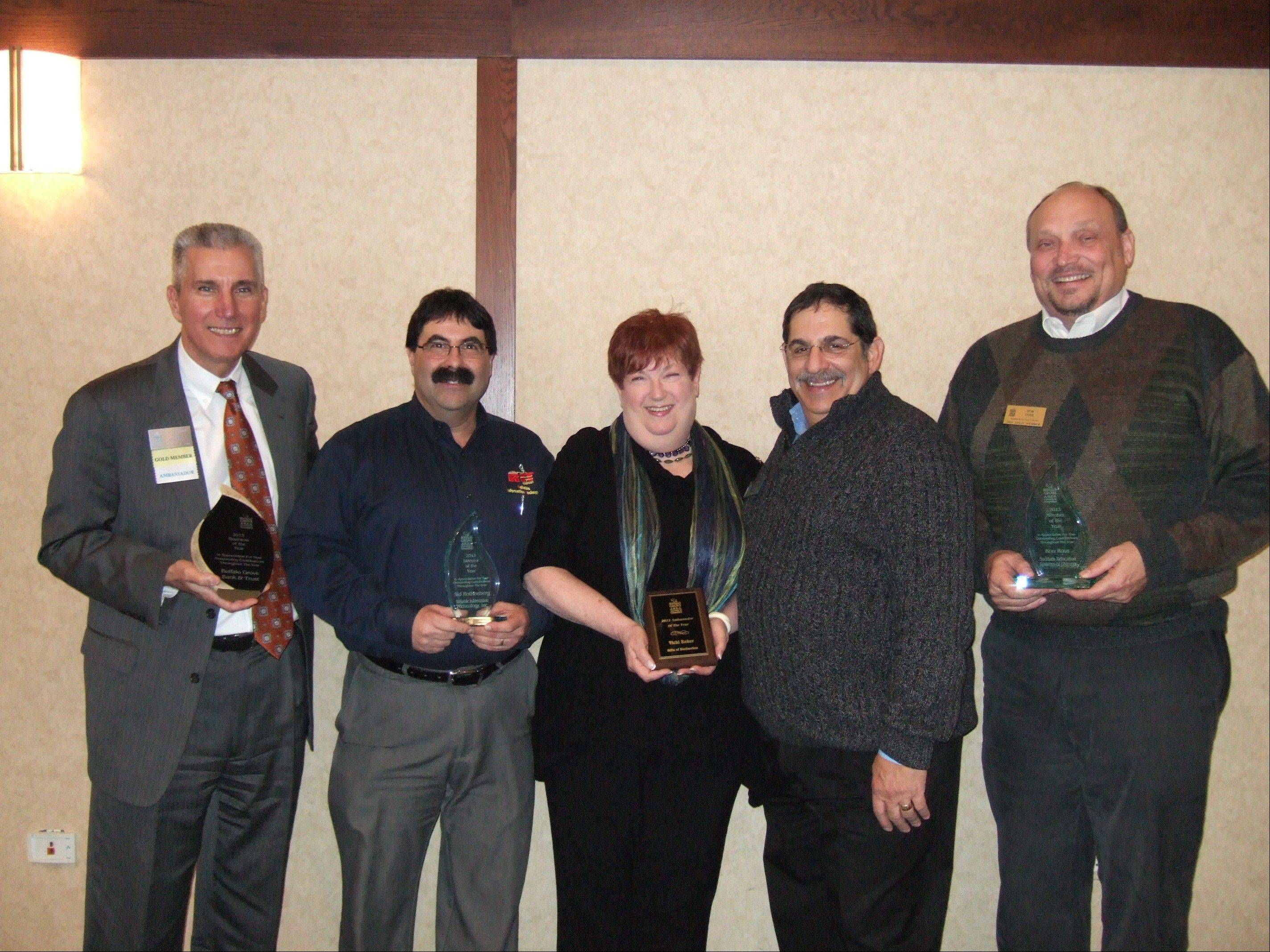 From left: Mike Abruzzini, who accepted the Business of the Year Award on behalf of Buffalo Grove Bank & Trust; Sid Rothenberg; Vicki Baker; Chamber Board President Scott Fishkin; and Ron Ross.