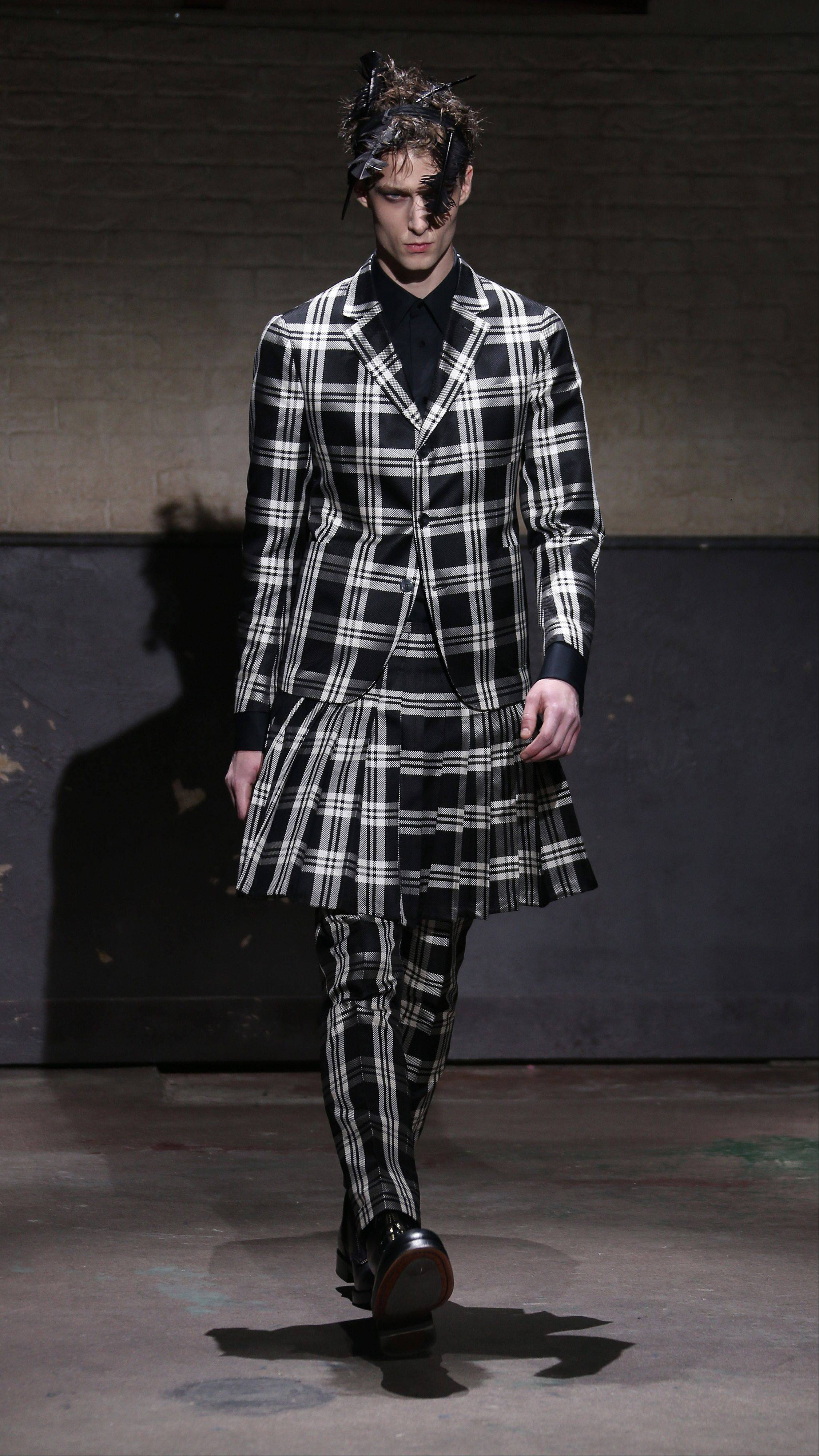 A model wears a design created by Alexander McQueen during London Collections for Men Autumn/Winter 2014 in London.