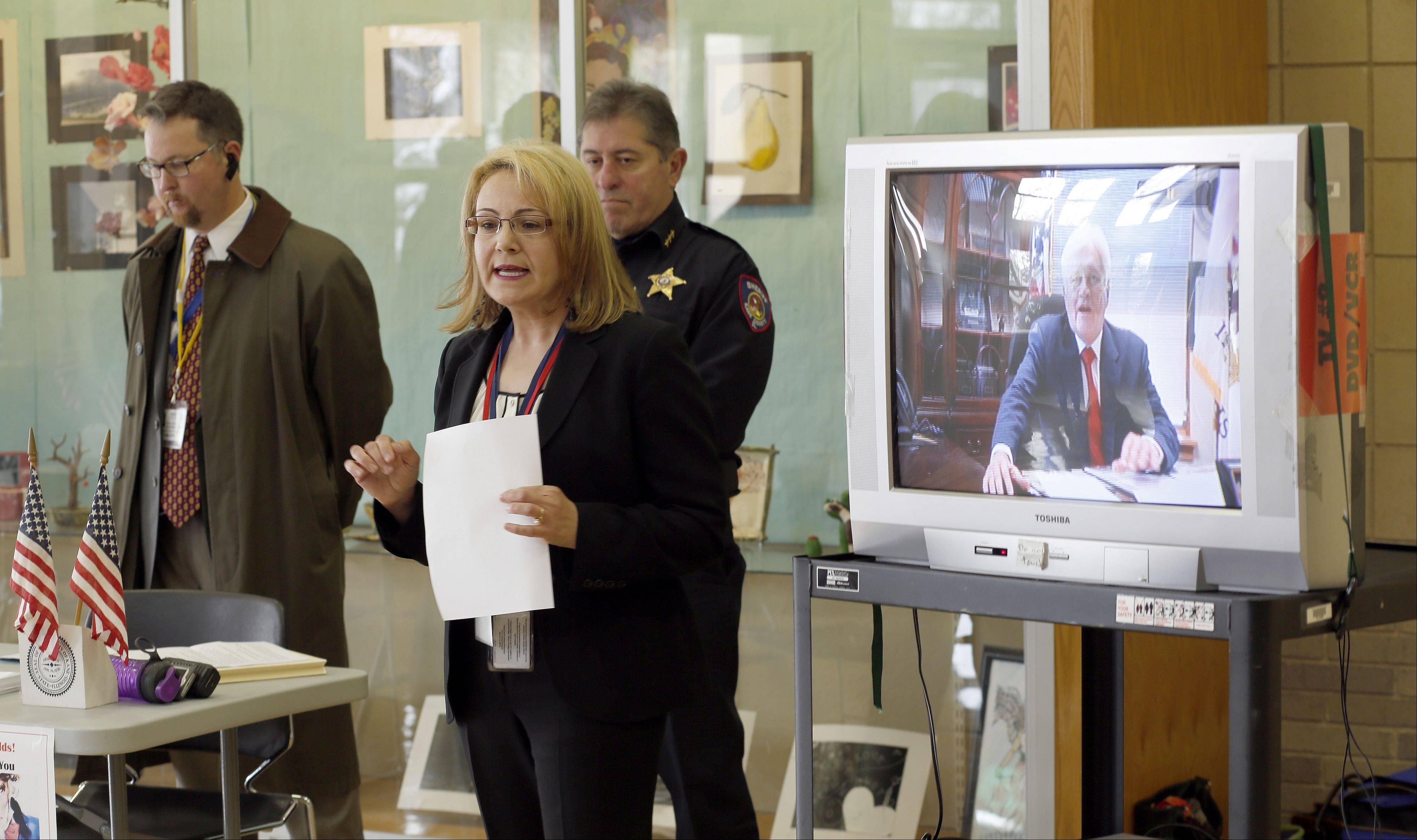 Suzanne Fahnestock, Kane County director of elections, represented Kane County Clerk Jack Cunningham, who appeared via video, as they unveiled a program Wednesday at Batavia High School to comply with a new law allowing 17-year-olds to register to vote.