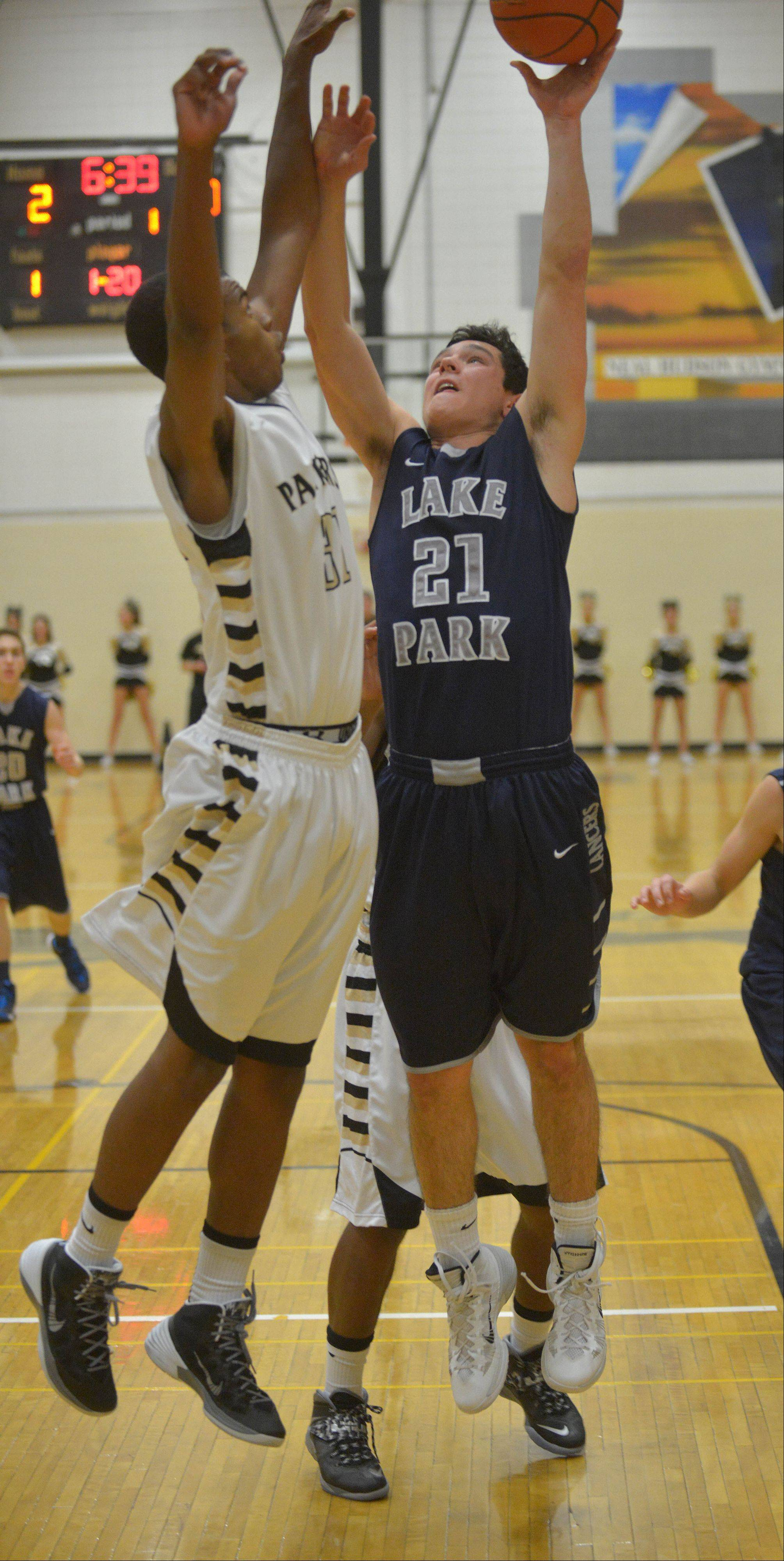 Chip Flanigan of Glenbard North and Michael Karas of Lake Park go for a rebound during the Lake Park at Glenbard North boys basketball game Friday.