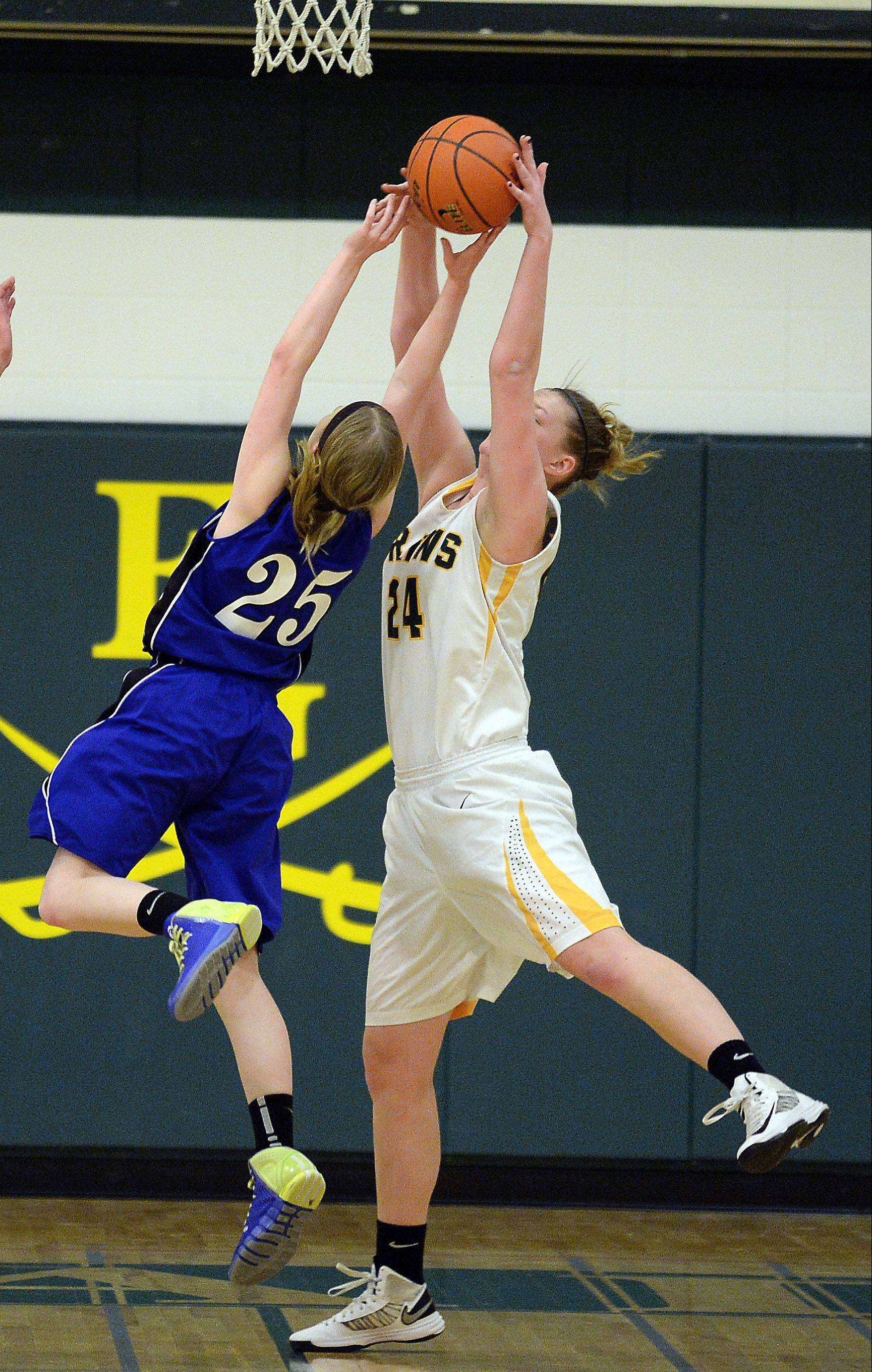 Lake Zurich�s Abby Pirron shoots for the basket but Elk Grove�s Amber Lindfors takes the ball away from her under the basket Thursday at Elk Grove.
