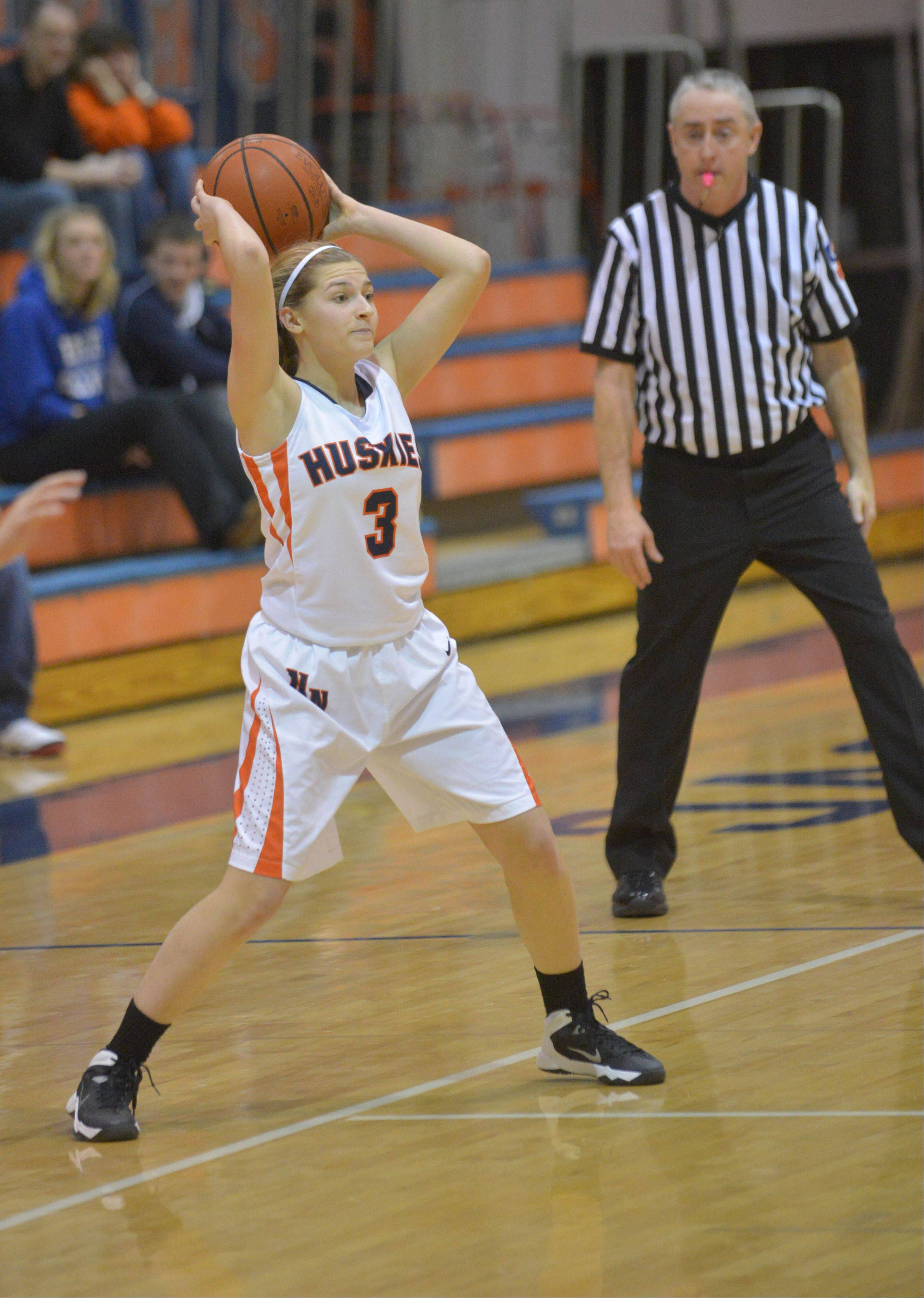Olivia Stapleton of Naperville North looks to pass during the Lake Park at Naperville North girls basketball game Thursday.