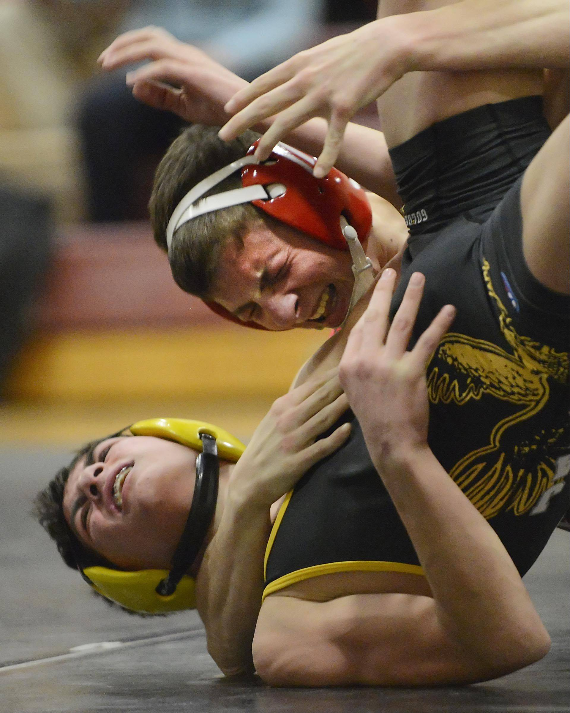 Huntley�s Nick Meyer, top, and Jacobs� David Dudych battle it out at 115 pounds Thursday in Huntley.