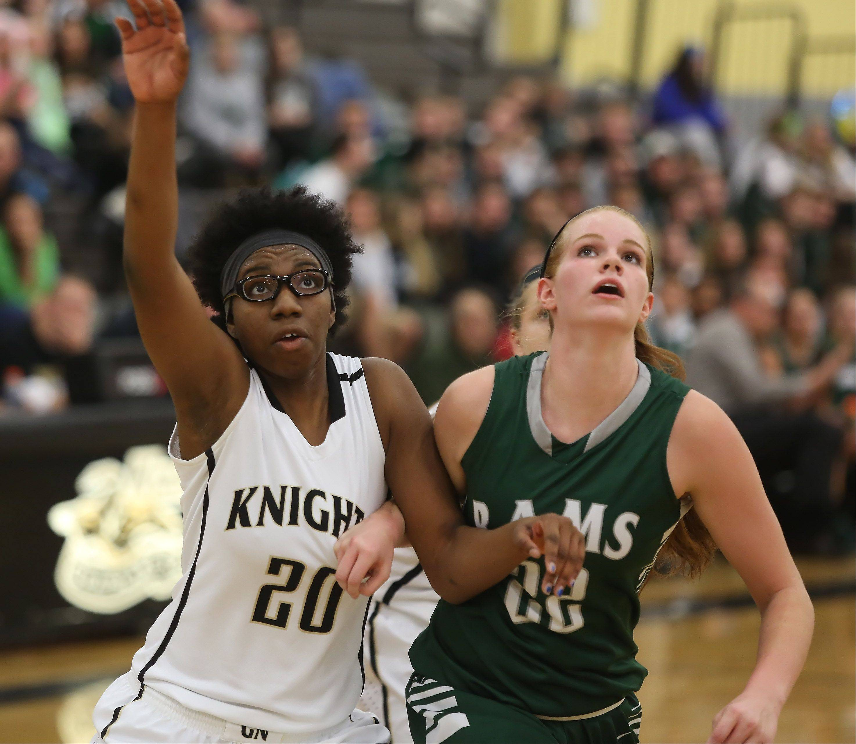 Grayslake North forward Brittney Thibeaux, left, battles Graylake Central forward Morgan Dahlstrom for a rebound .