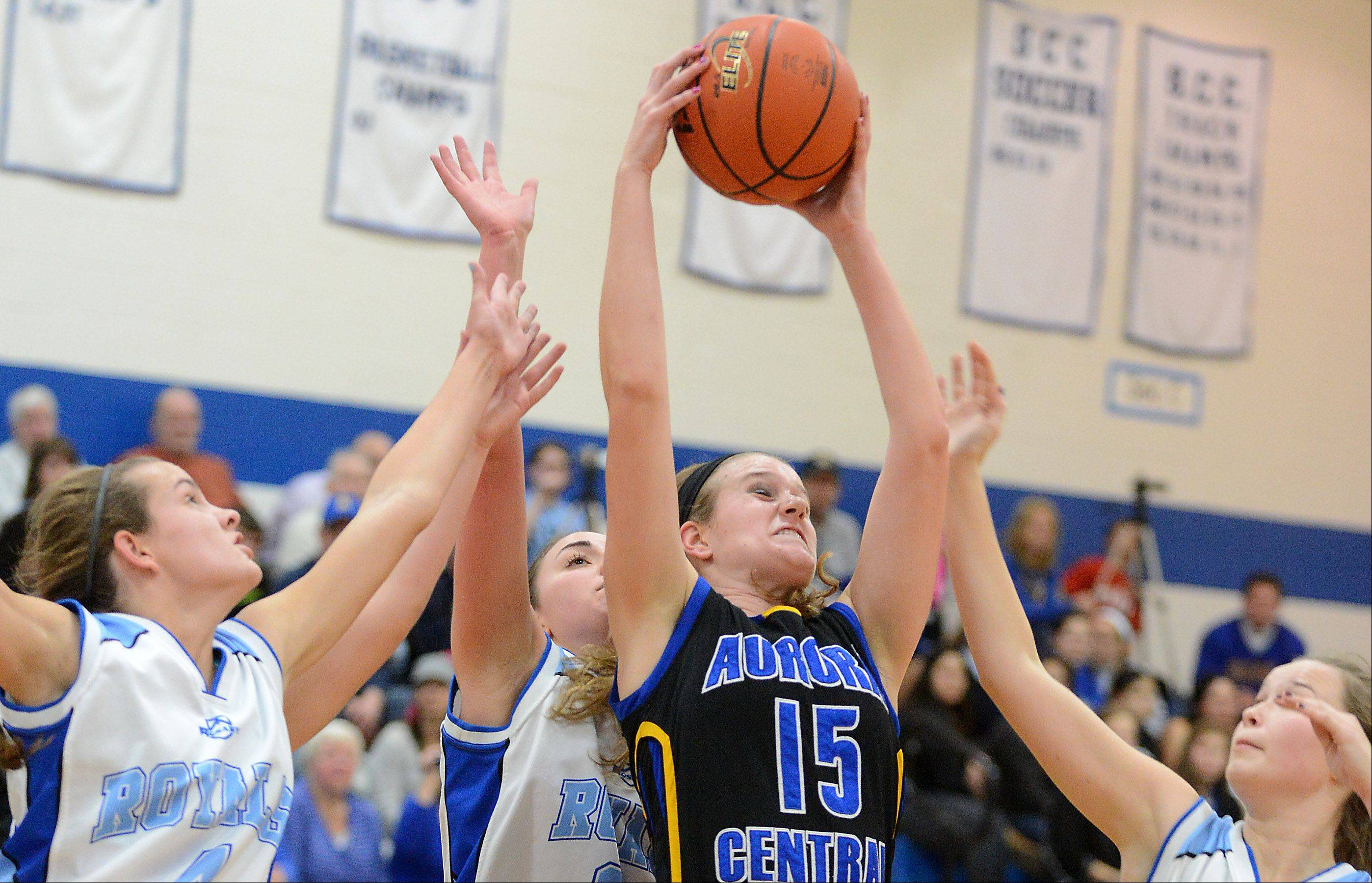 Aurora Central Catholic�s Natalie Droeske pulls down a rebound while surrounded by Rosary players.