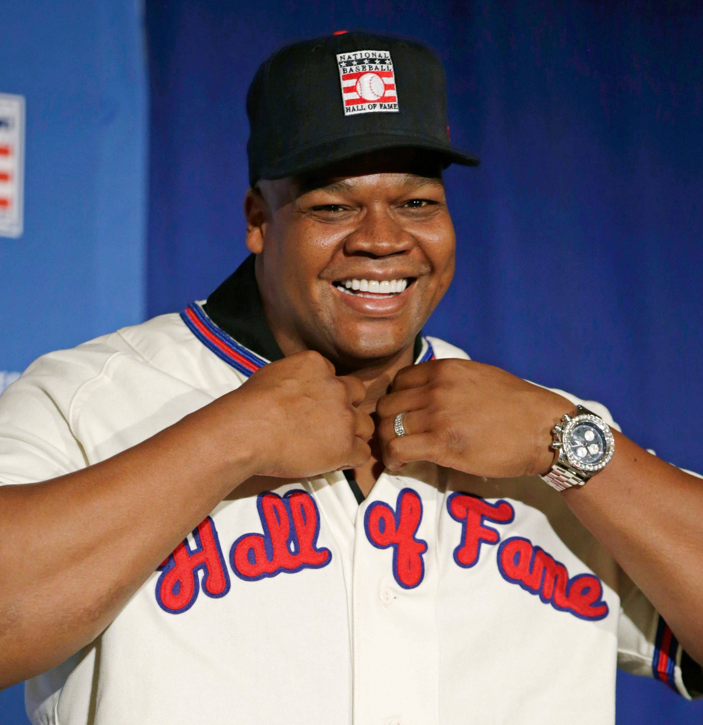 White Sox slugger Frank Thomas dons his Hall of Fame cap and jersey during a press conference announcing his election into the National Baseball Hall of Fame on Thursday in New York.