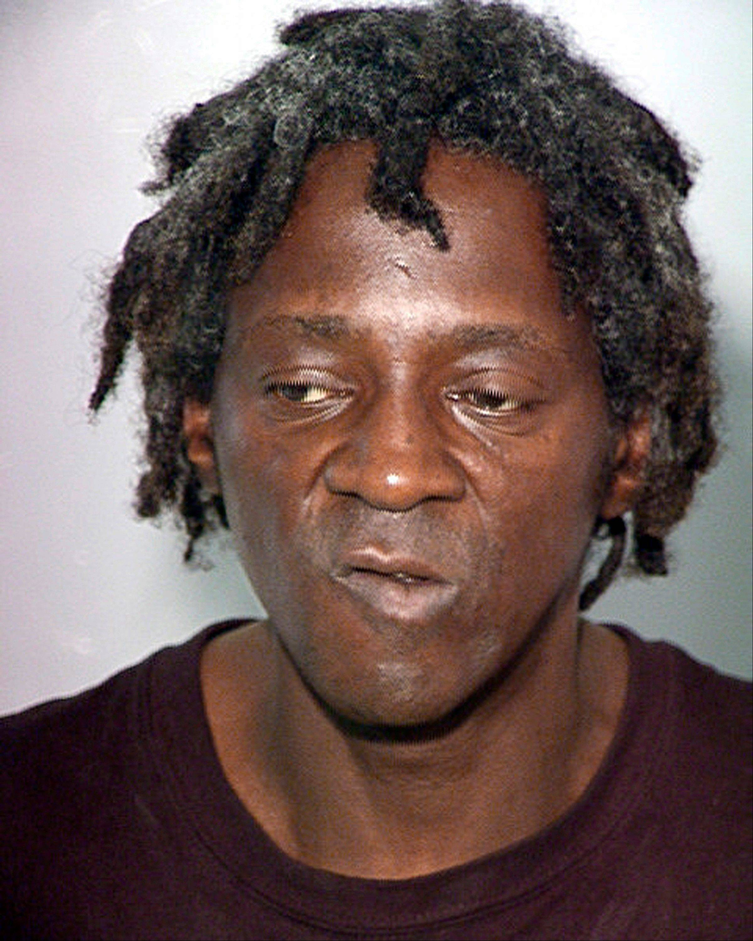 FILE -This Oct. 17, 2012, file photo provided by the Las Vegas Police Department, shows rapper Flavor Flav, whose real name is William Jonathan Drayton Jr. New York State police say rapper and Rock and Roll Hall of Famer was ticketed for speeding and driving without a license while en route to his motherís funeral in suburban New York, Thursday, Jan. 9, 2014.