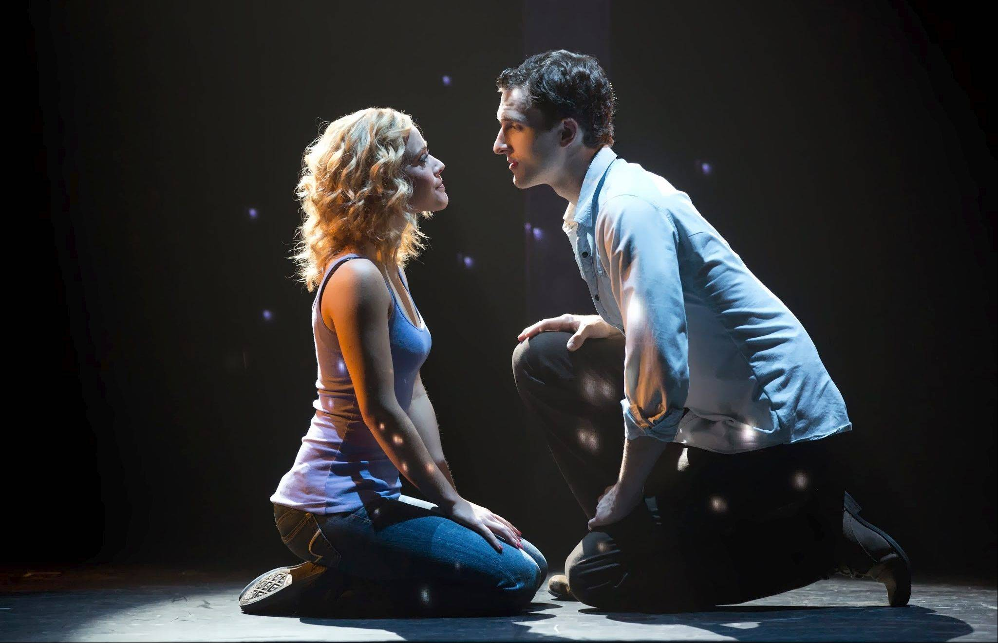 "Katie Postotnik and Steven Grant Douglas star in the national tour of the London and Broadway show ""Ghost The Musical"" adapted from the hit 1990 film. ""Ghost The Musical"" plays Chicago's Oriental Theatre through Sunday, Jan. 19."