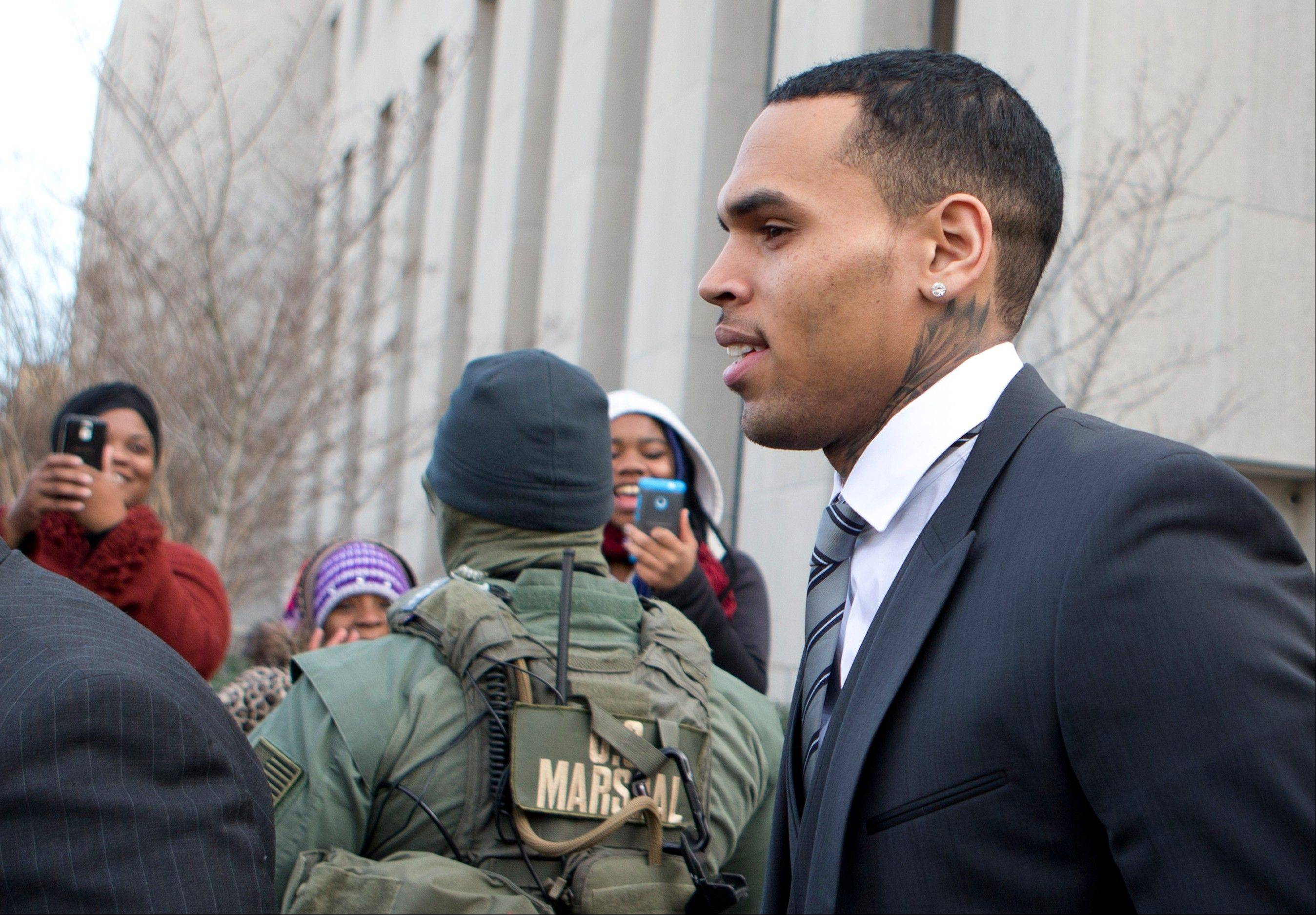 Singer Chris Brown leaves the District of Columbia Superior Court in Washington Wednesday. Lawyers for Brown say the singer has rejected a plea deal in a case in which he's accused of hitting a man outside a Washington hotel.
