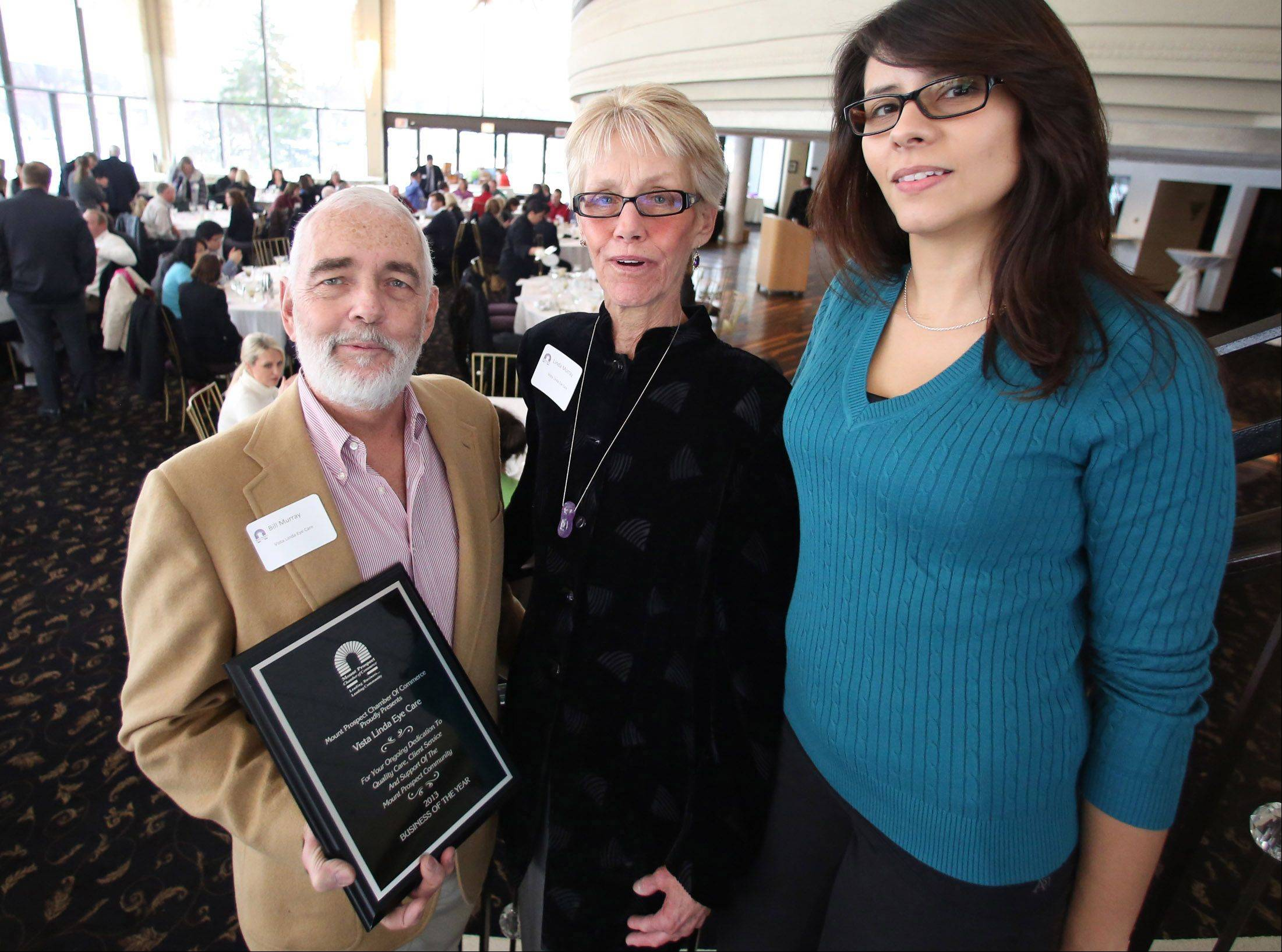 During the Mount Prospect Chamber of Commerce's Dynamic Year luncheon Vista Linda Eye Care was named business of the year. Owners Bill Murray and his wife Dr. Linda Murray and manager Adriana Smith at right pose with the plaque.