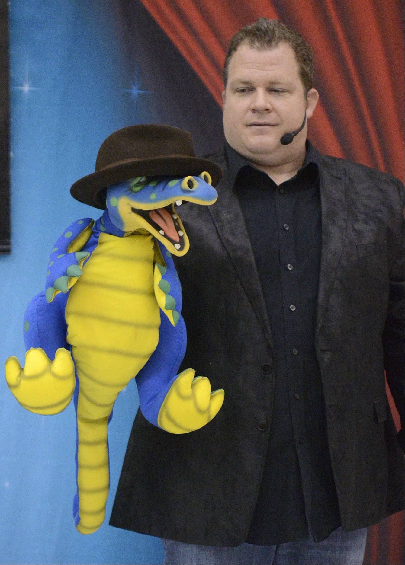 "Chris McBrien of Lisle, known as ""The Magic Storyteller,"" teaches students about respect with his puppet, Lucky, during his ""Team Bully Free"" program Thursday at Washington Elementary School in Elgin. McBrien challenged Lucky to make the kids laugh without disrespecting him, so he wore McBrien's hat, which had the kids roaring with laughter."