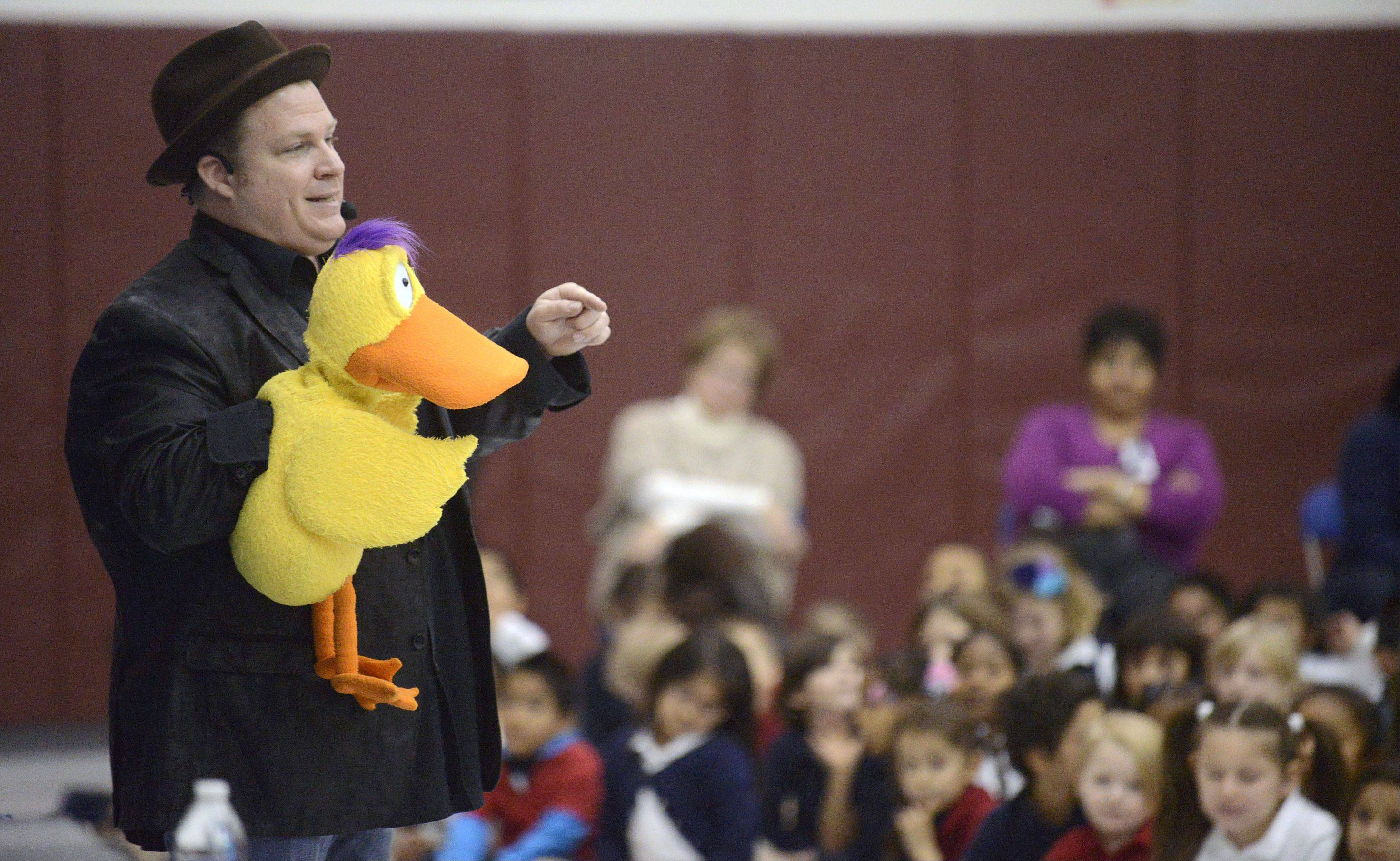 "Chris McBrien and Dewey the Duck perform his ""Team Bully Free"" program for students Thursday at Washington Elementary School in Elgin."