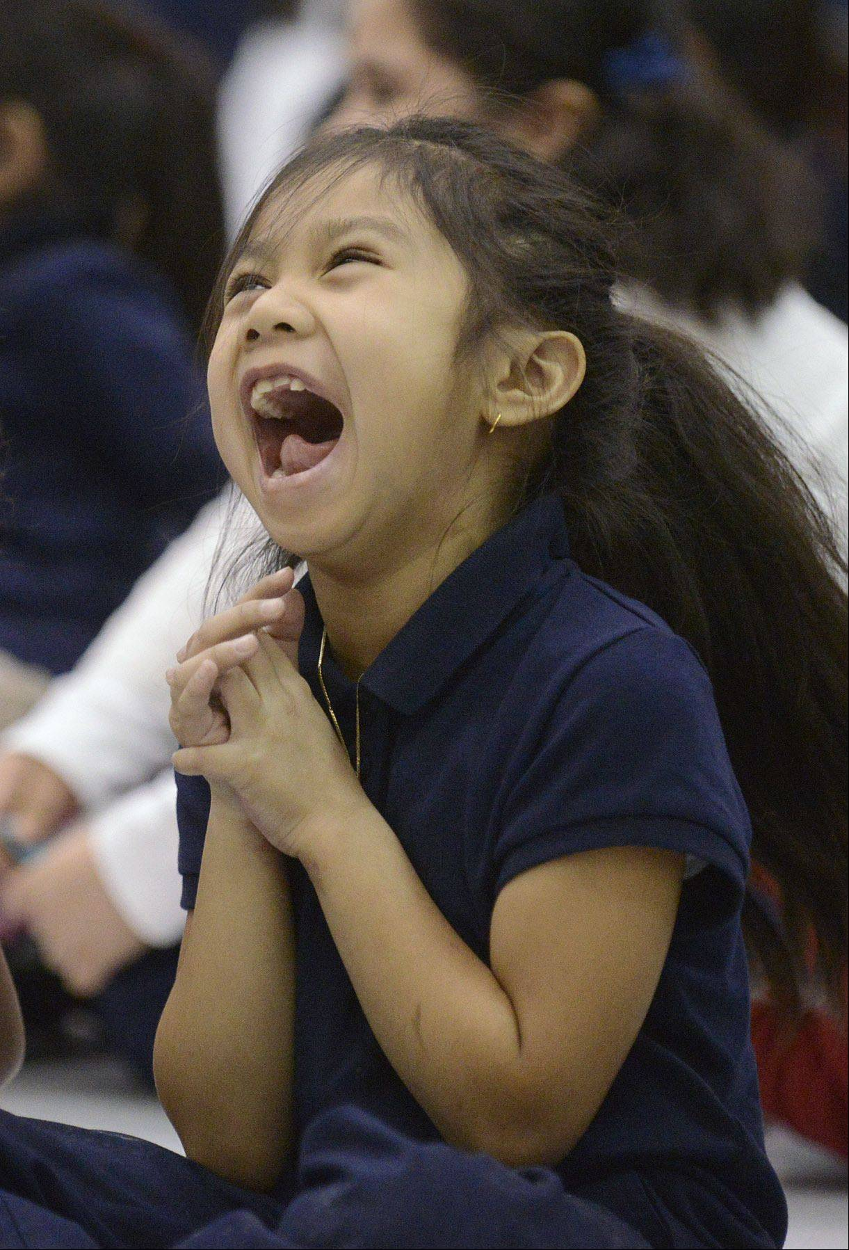 "First-grader Destiny Sanasing, 7, has a fit of the giggles while Chris McBrien and one of his puppets perform his ""Team Bully Free"" program Thursday at Washington Elementary School in Elgin."