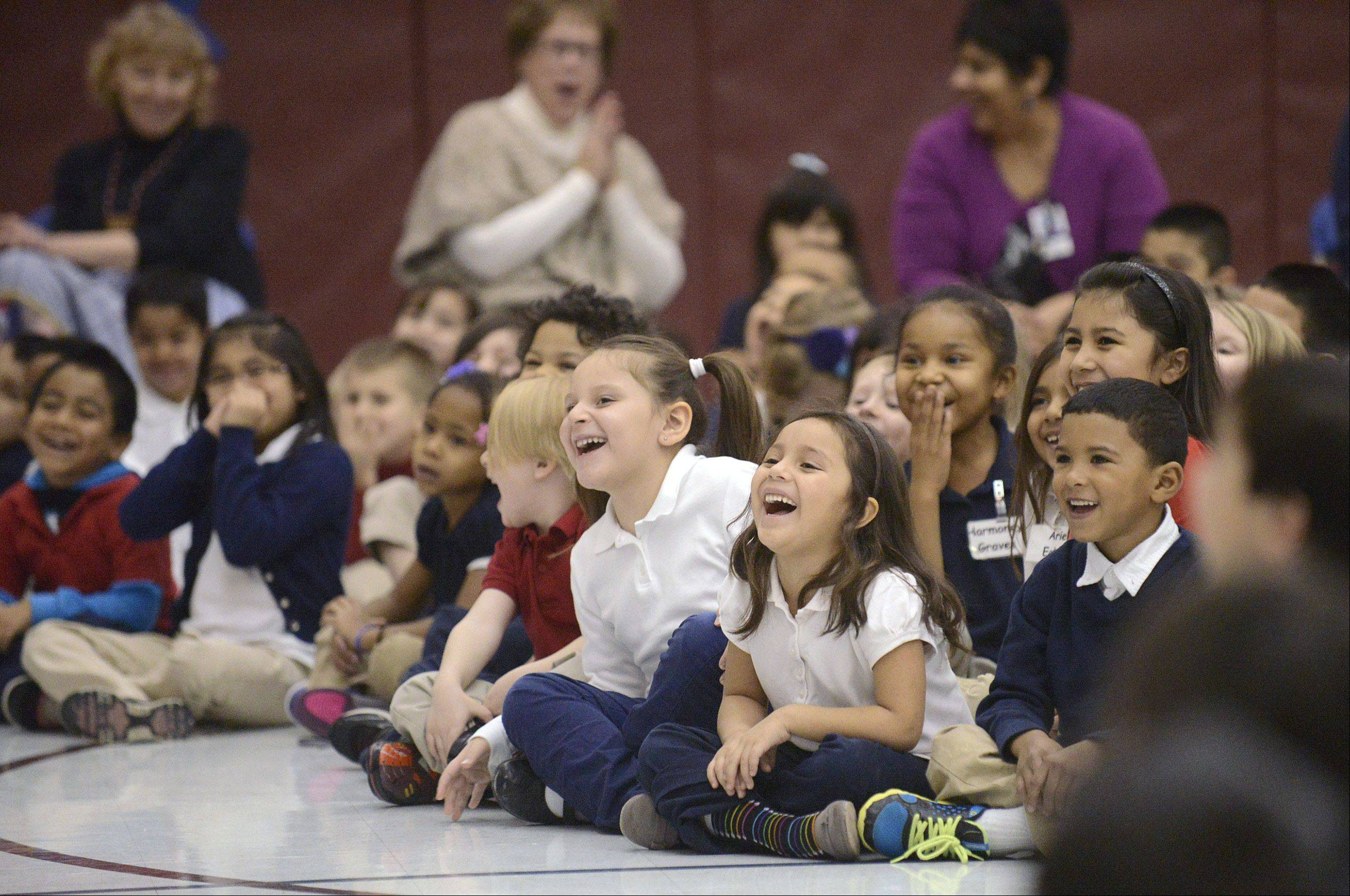 "Students and teachers burst out in laughter during Chris McBrien's ""Team Bully Free"" program Thursday at Washington Elementary School in Elgin."