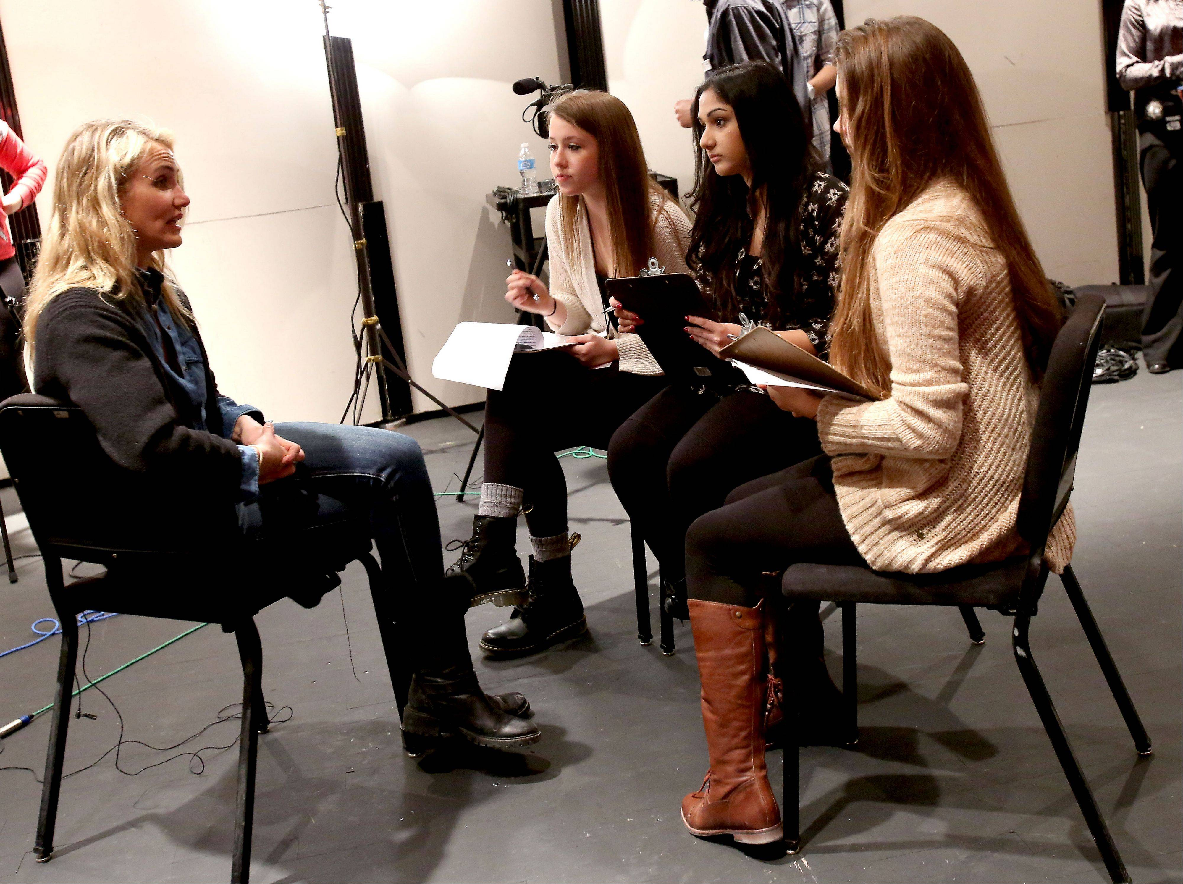 "Actress and author Cameron Diaz answers questions from Neuqua Valley High School newspaper staffers junior Sydney Kalich and seniors Sara Saggar and Riley Wagner before talking about her new book ""The Body Book: The Law of Hunger, the Science of Strength and Other Ways to Love Your Amazing Body."""