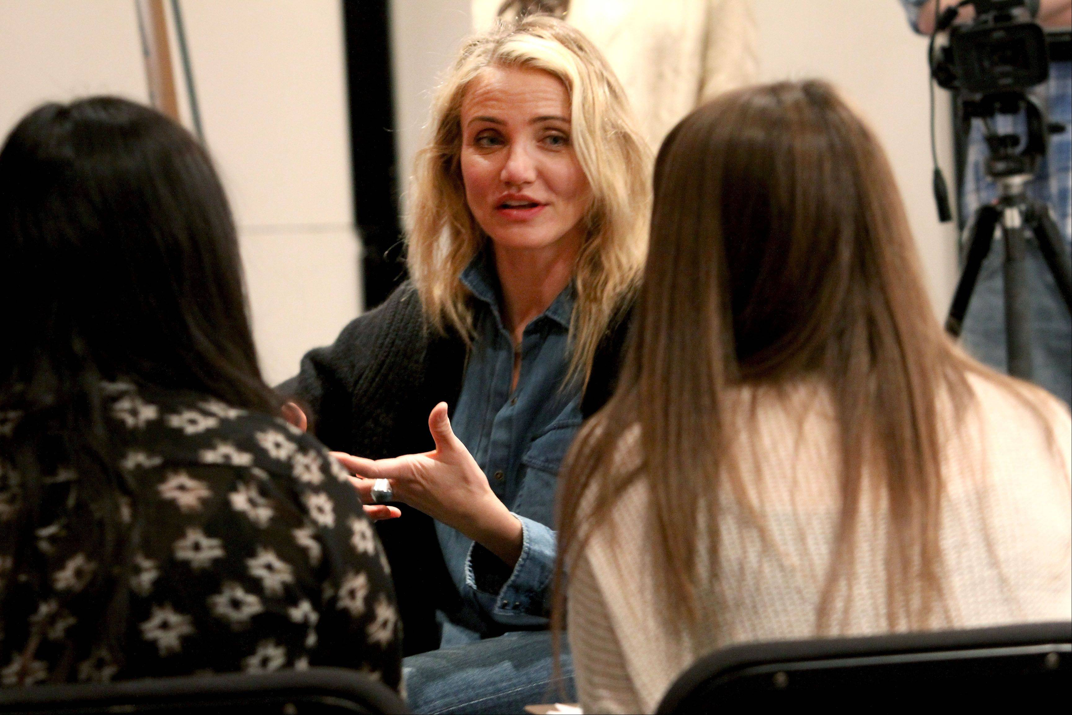"Actress Cameron Diaz is interviewed by Neuqua Valley High School students before speaking Thursday in Naperville about her new book ""The Body Book: The Law of Hunger, the Science of Strength and Other Ways to Love Your Amazing Body."""