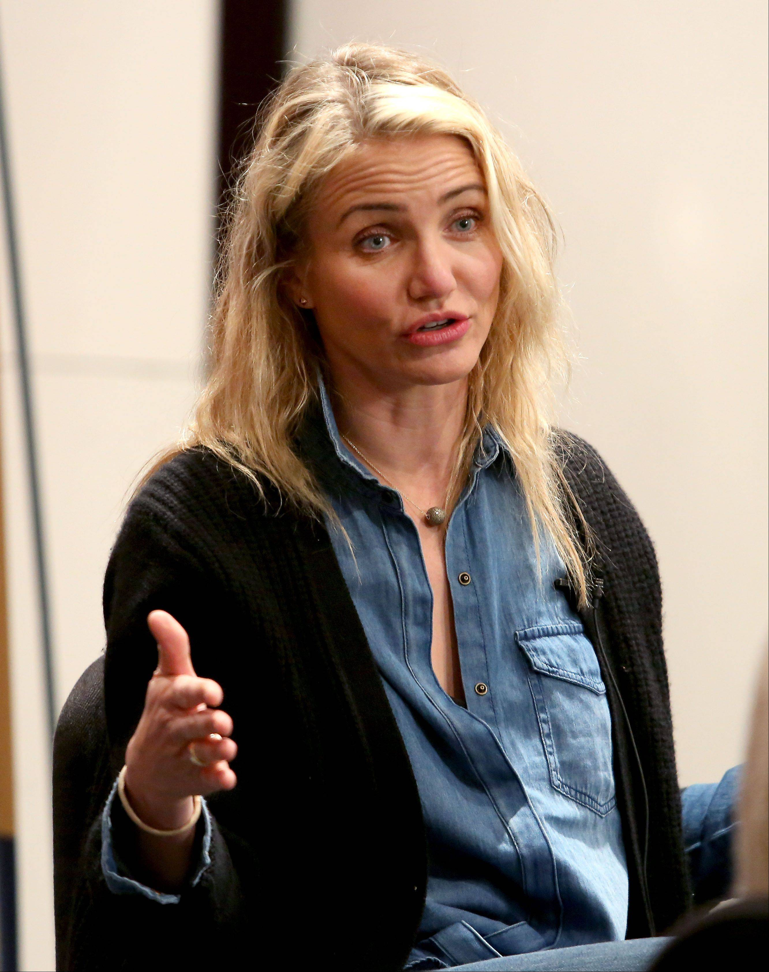 "Actress Cameron Diaz tells Neuqua Valley High School student journalists about her new book ""The Body Book: The Law of Hunger, the Science of Strength and Other Ways to Love Your Amazing Body,"" as part of two appearances she made Thursday in Naperville."