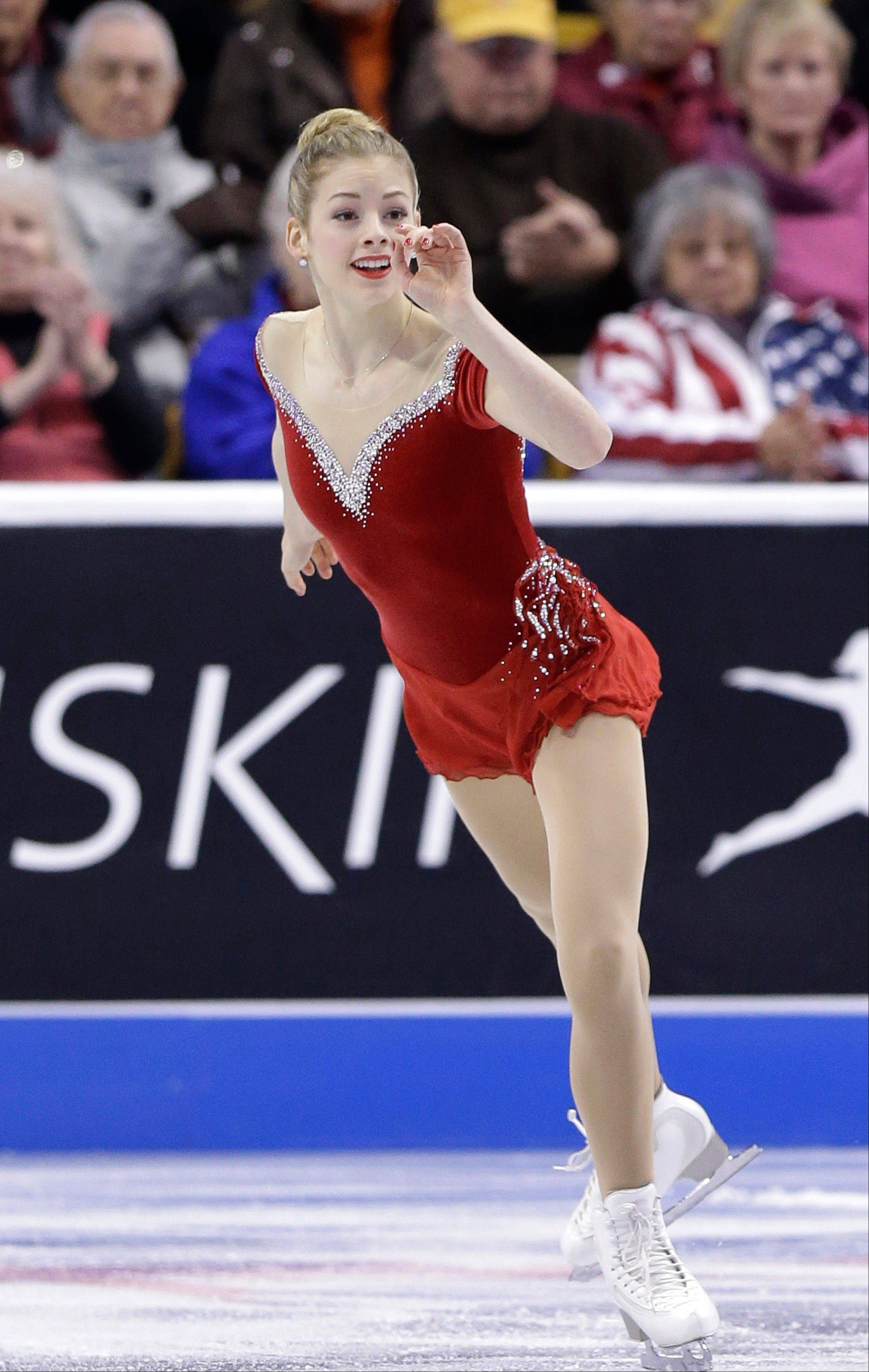 "Elk Grove Village native Gracie Gold skates to ""Piano Concerto"" during the women's short program at the U.S. Figure Skating Championships on Thursday in Boston."