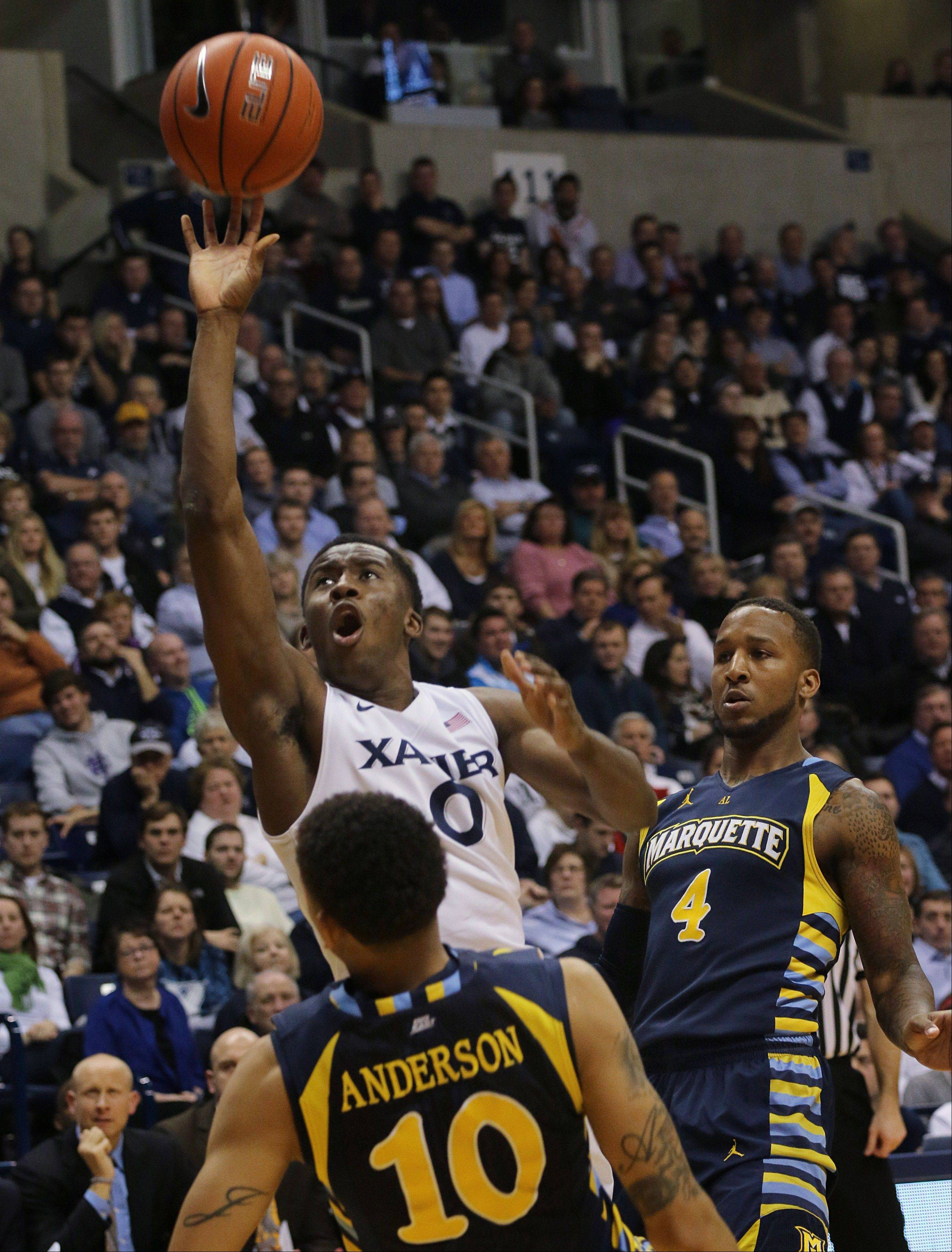 Xavier's Semaj Christon shoots past Marquette's Juan Anderson and Todd Mayo in the second half of Thursday's game in Cincinnati.