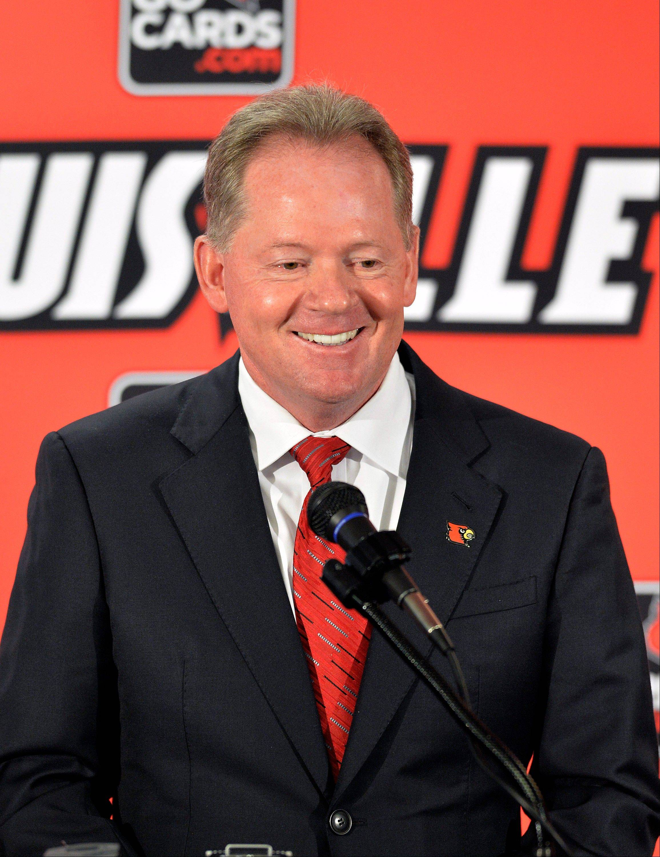 New Louisville head football coach Bobby Petrino address reporters following the announcement of his hiring Thursday at Papa John's Cardinal Stadium in Louisville, Ky.