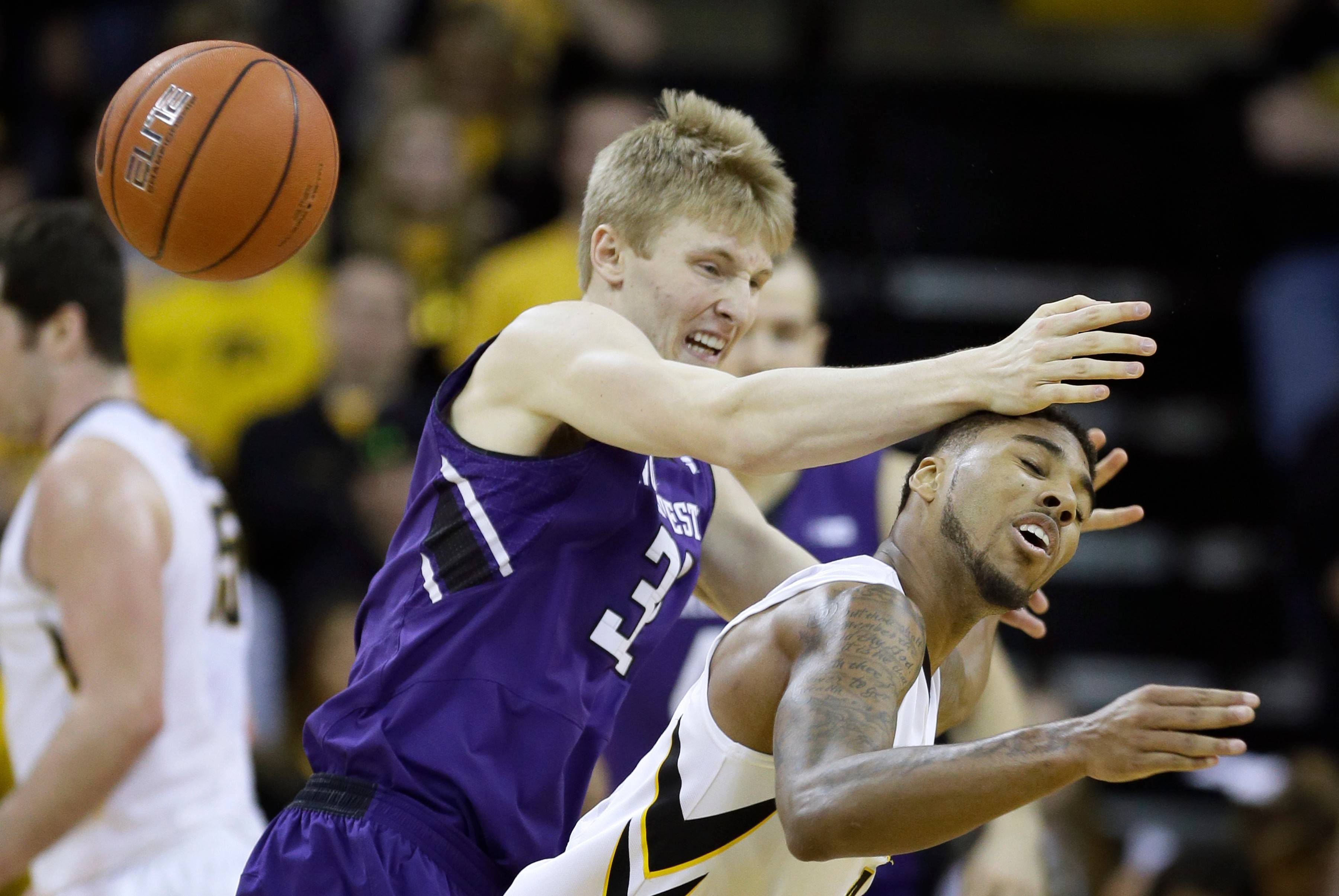 Iowa guard Devyn Marble, right, steals the ball from Northwestern forward Nathan Taphorn during the second half Thursday's game in Iowa City.