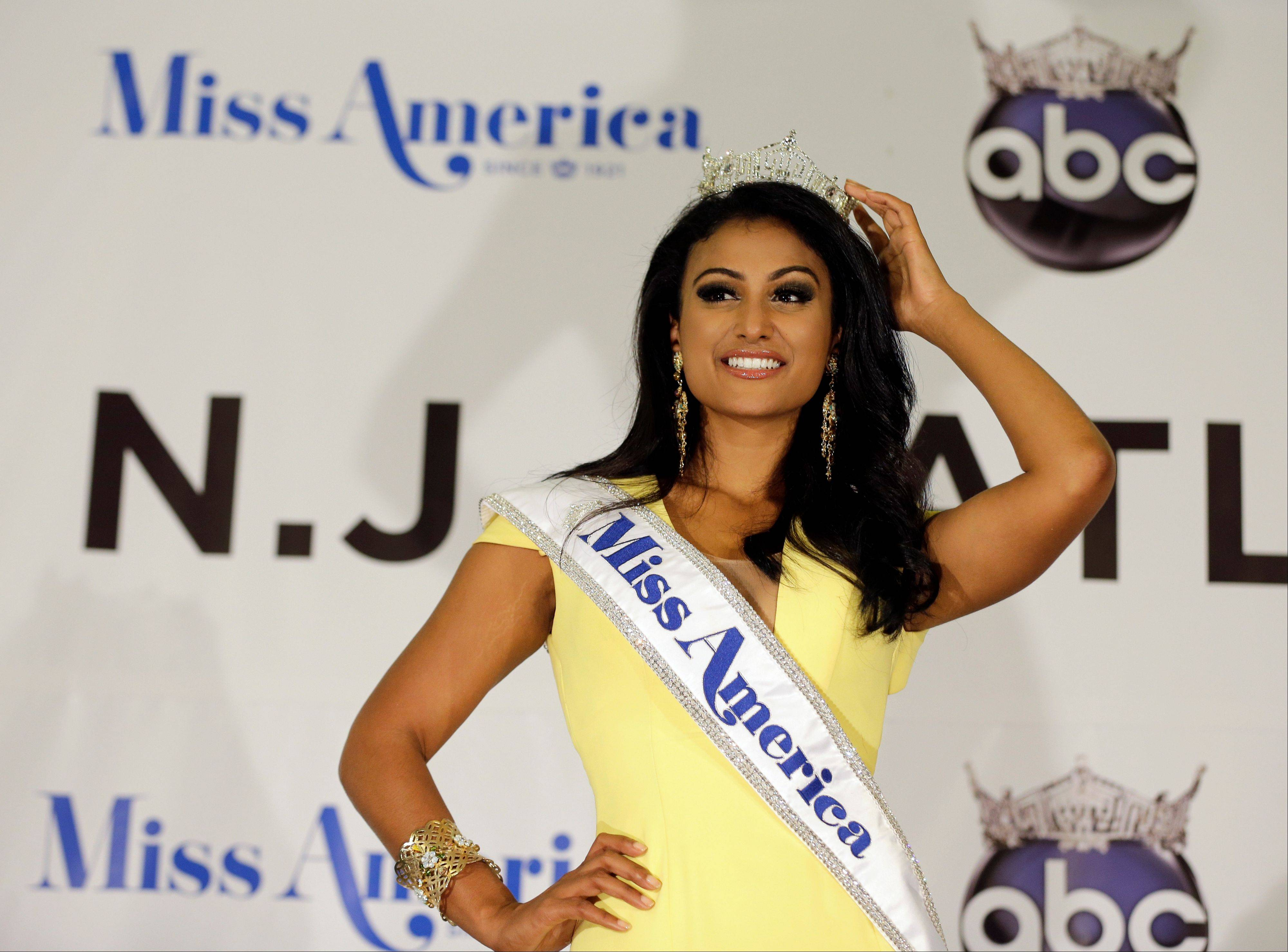 Miss America Nina Davuluri poses for photographers following her crowning in Atlantic City, N.J. Davuluri will be at the Stevenson High School World's Fair on Saturday, Jan. 25.