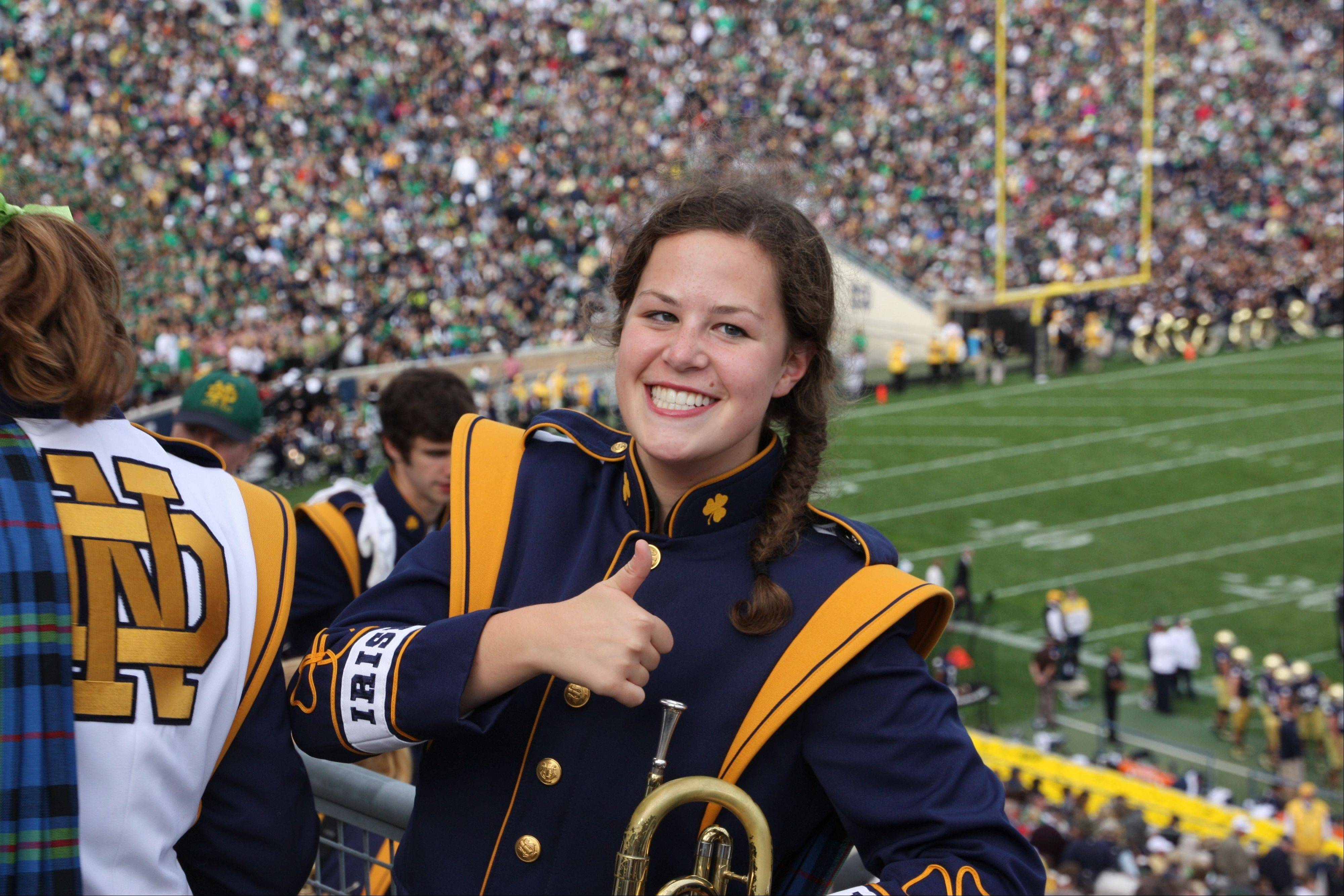 Maureen Daday of Arlington Heights gives a thumbs-up at a Notre Dame home game. She accompanied the band to the New Era Pinstripe Bowl at Yankee Stadium in New York