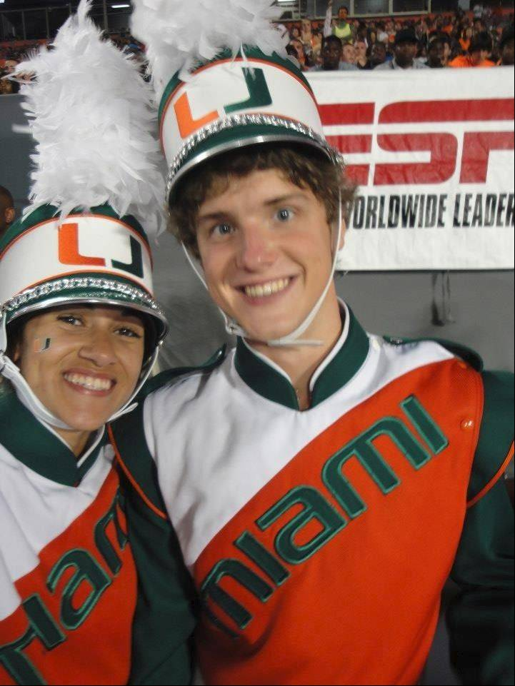 Jonathon Schening of Arlington Heights plays clarinet with the University of Miami marching band. They took the field when the Hurricanes played the Louisville Cardinals at the Russell Athletic Bowl in Orlando