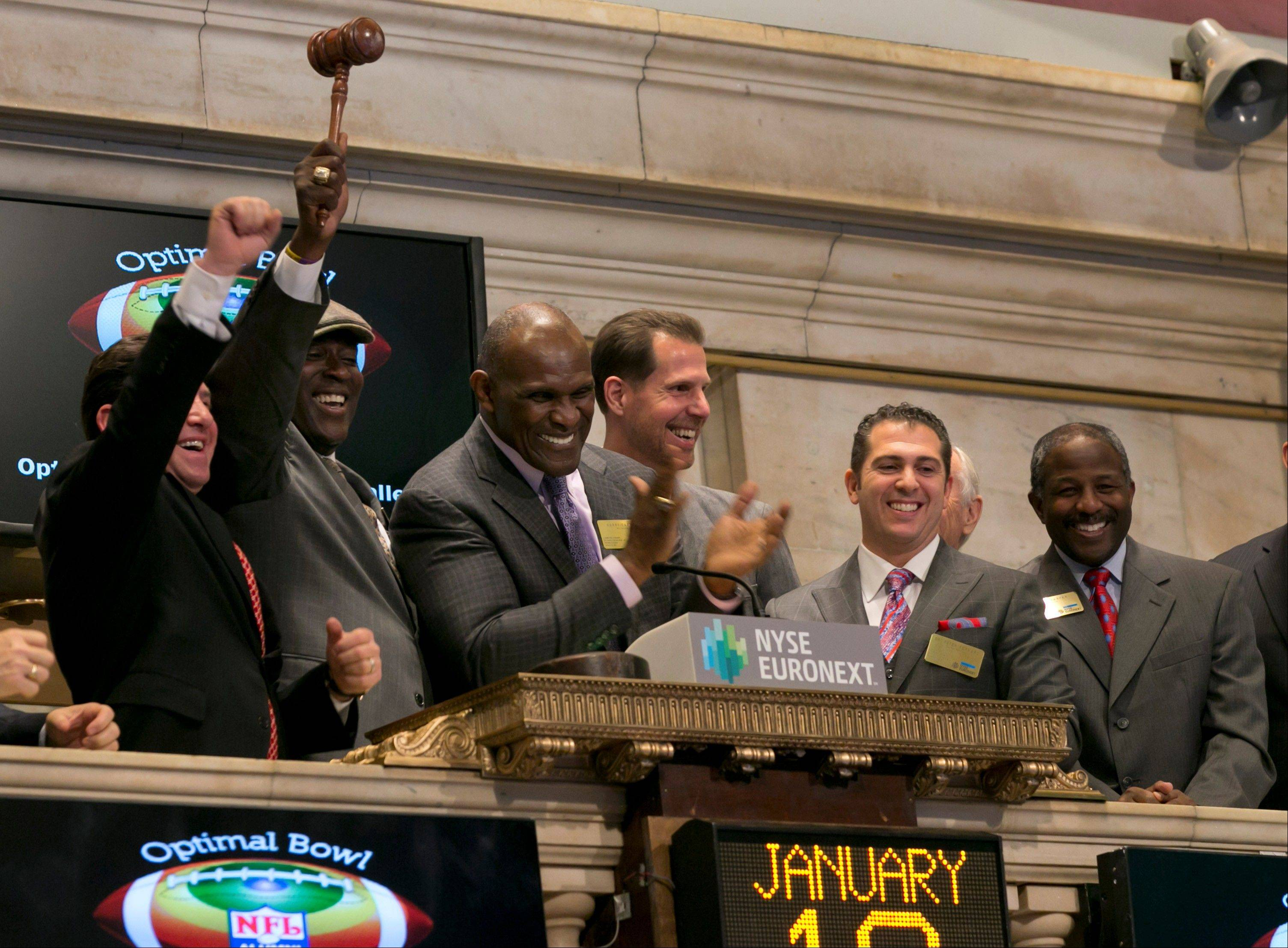 Dr. George Shapiro, former NY Giants Ottis Anderson, Harry Carson and Carl Nelson, with Dr. Peter Ferraro and former NY Jets Bruce Harper, left to right, celebrate the NFL Alumni Optimal Bowl & Wellness Challenge during closing bell ceremonies at the New York Stock Exchange Friday.