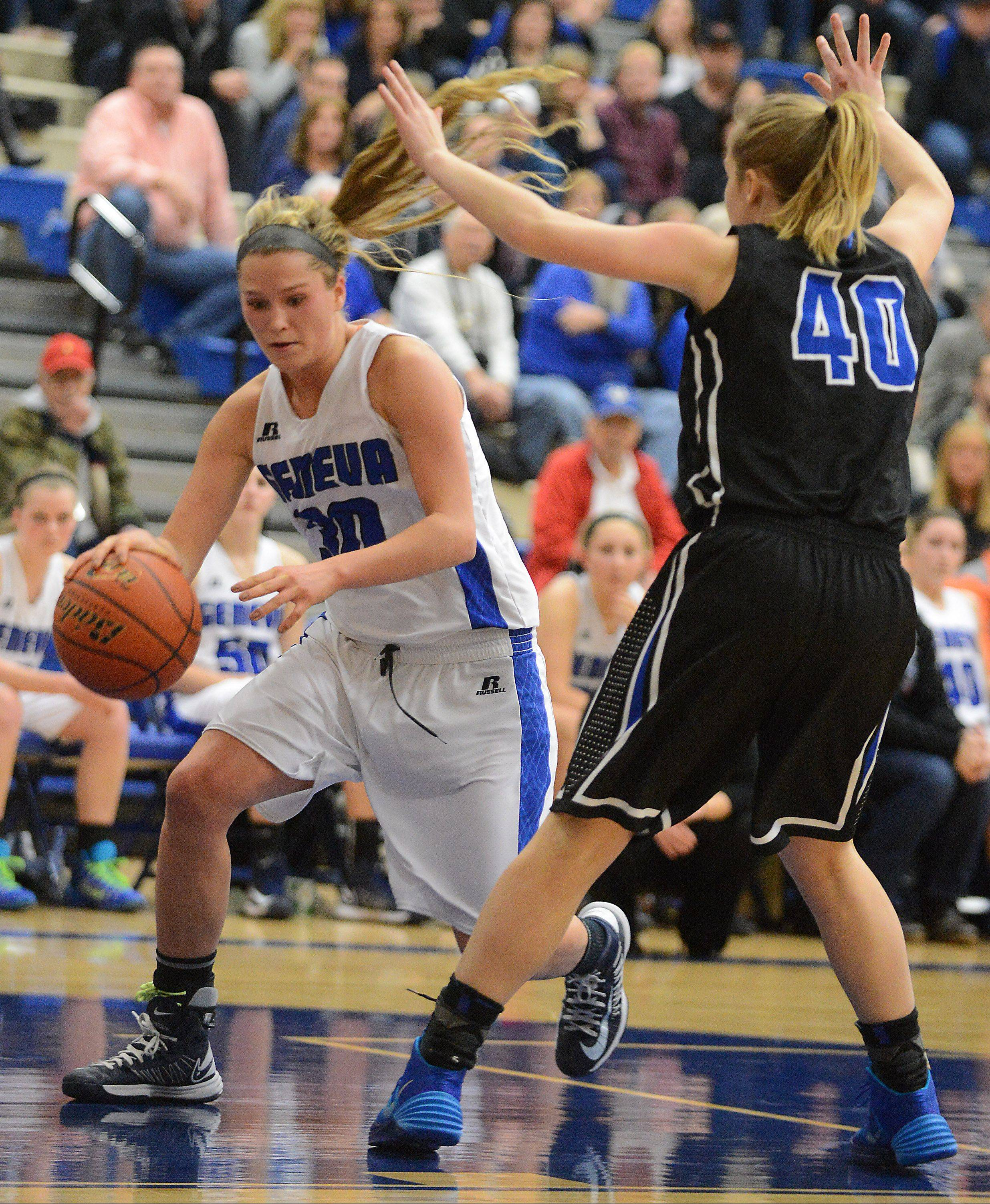 Geneva�s Janie McCloughan drives to the basket against St. Charles North�s Abby Mackay-Zacker during Friday�s game.