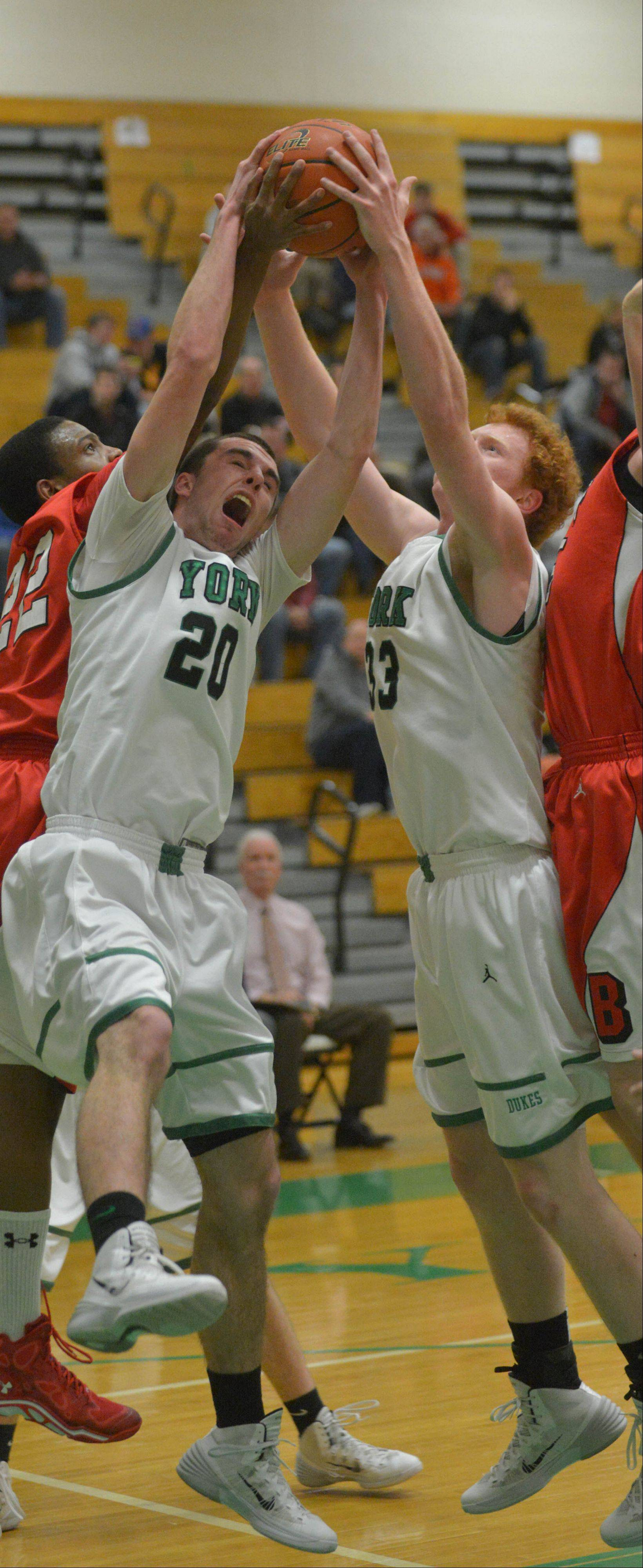 Charlie Rose and Frank Toohey of York pull down a rebound.