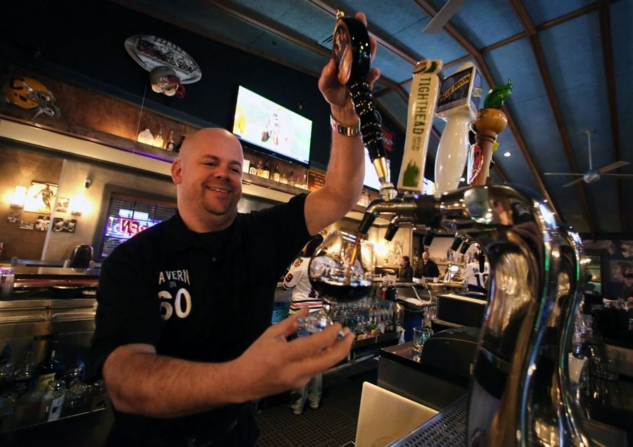Owner David Pedersen draws a root beer at Tavern on 60.