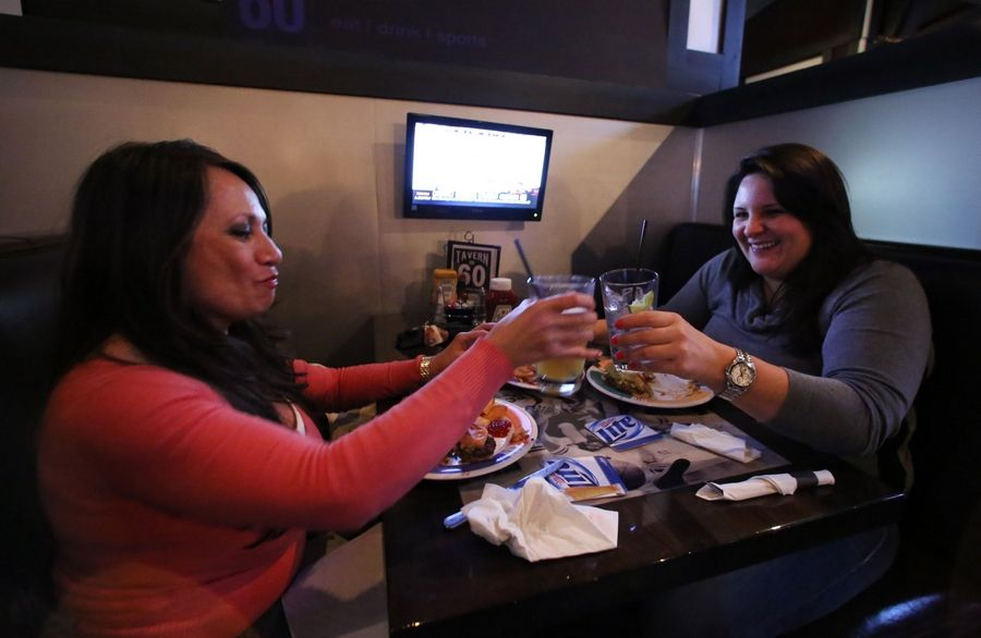 Anna Braun of Lake Villa and Veronika Jerikova of Wisconsin enjoy a night out at Tavern on 60 in Mundelein.