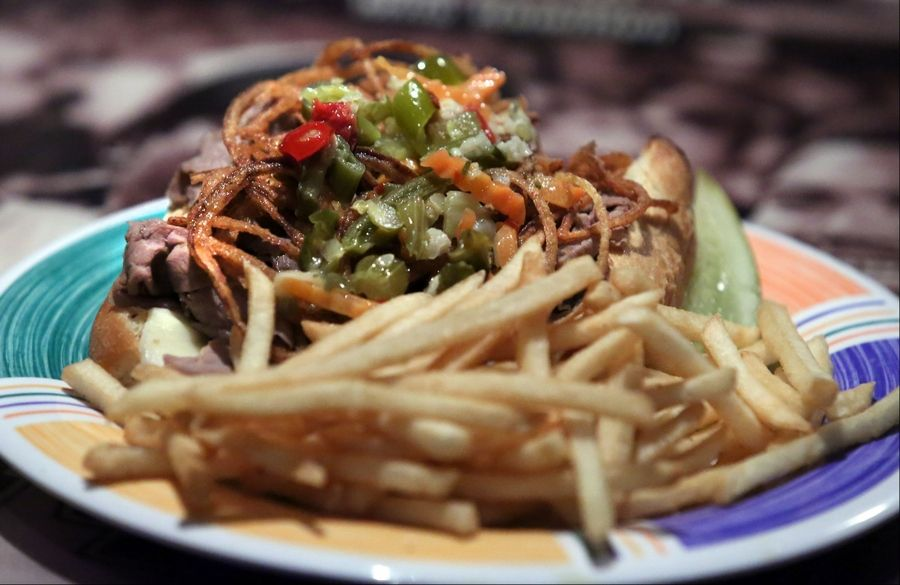 "The ""Mundi"" melt at Tavern on 60 is an open-faced Italian beef sandwich with crispy onions, giardiniera and melted mozzarella."