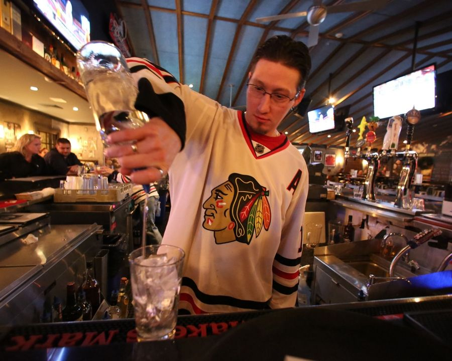 Bartender Scott Taggart pours a drink at Tavern on 60 in Mundelein.