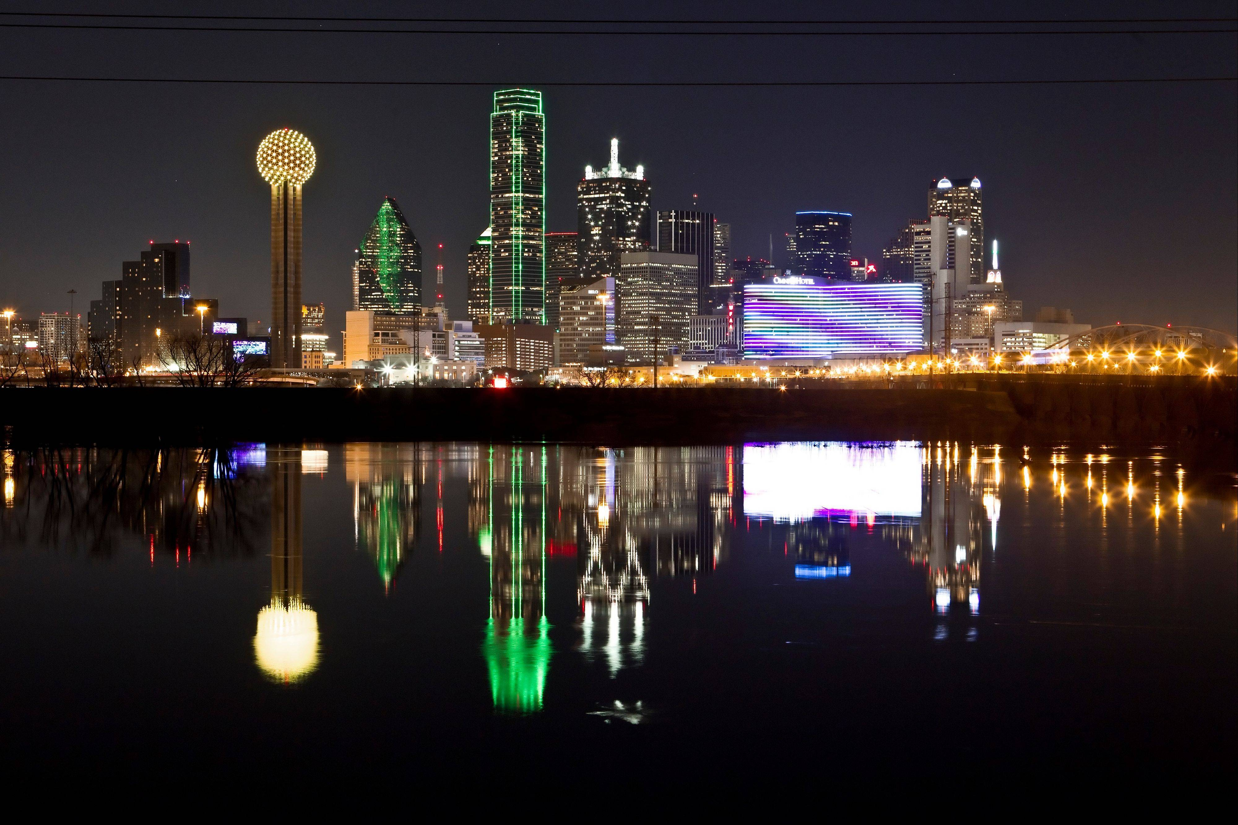 The Dallas skyline is reflected in the Trinity River.