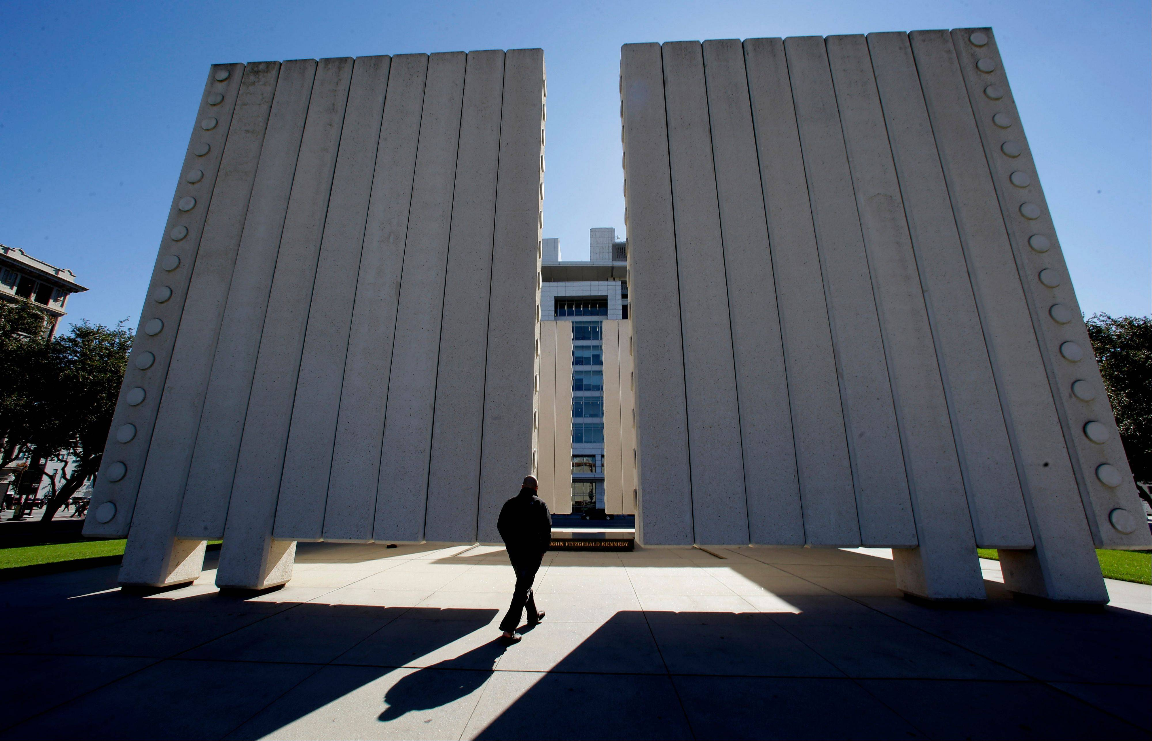 Visitor Chris Carson admires the John Fitzgerald Kennedy Memorial in downtown Dallas.