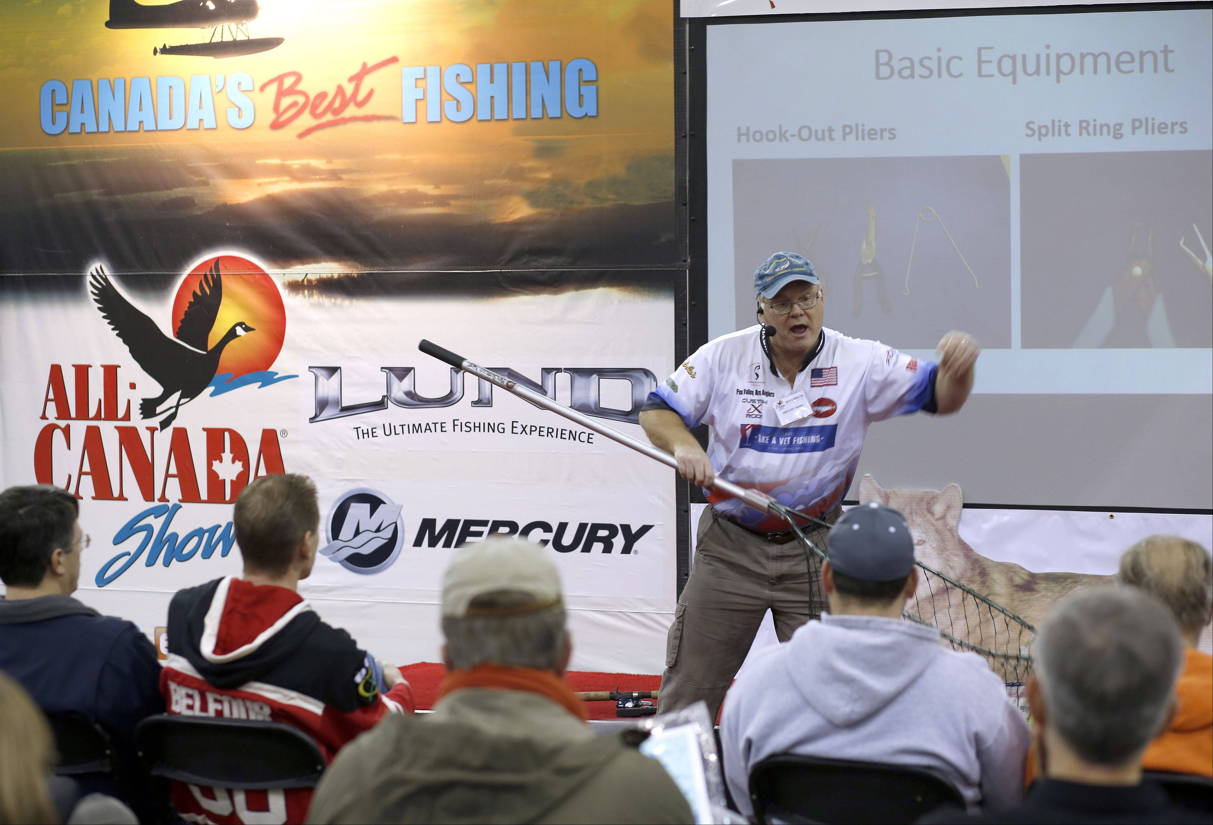 Presenter Ken Kuhnle talks about preparing for pike and muskie fishing Saturday during the annual All-Canada Show at Pheasant Run in St. Charles.