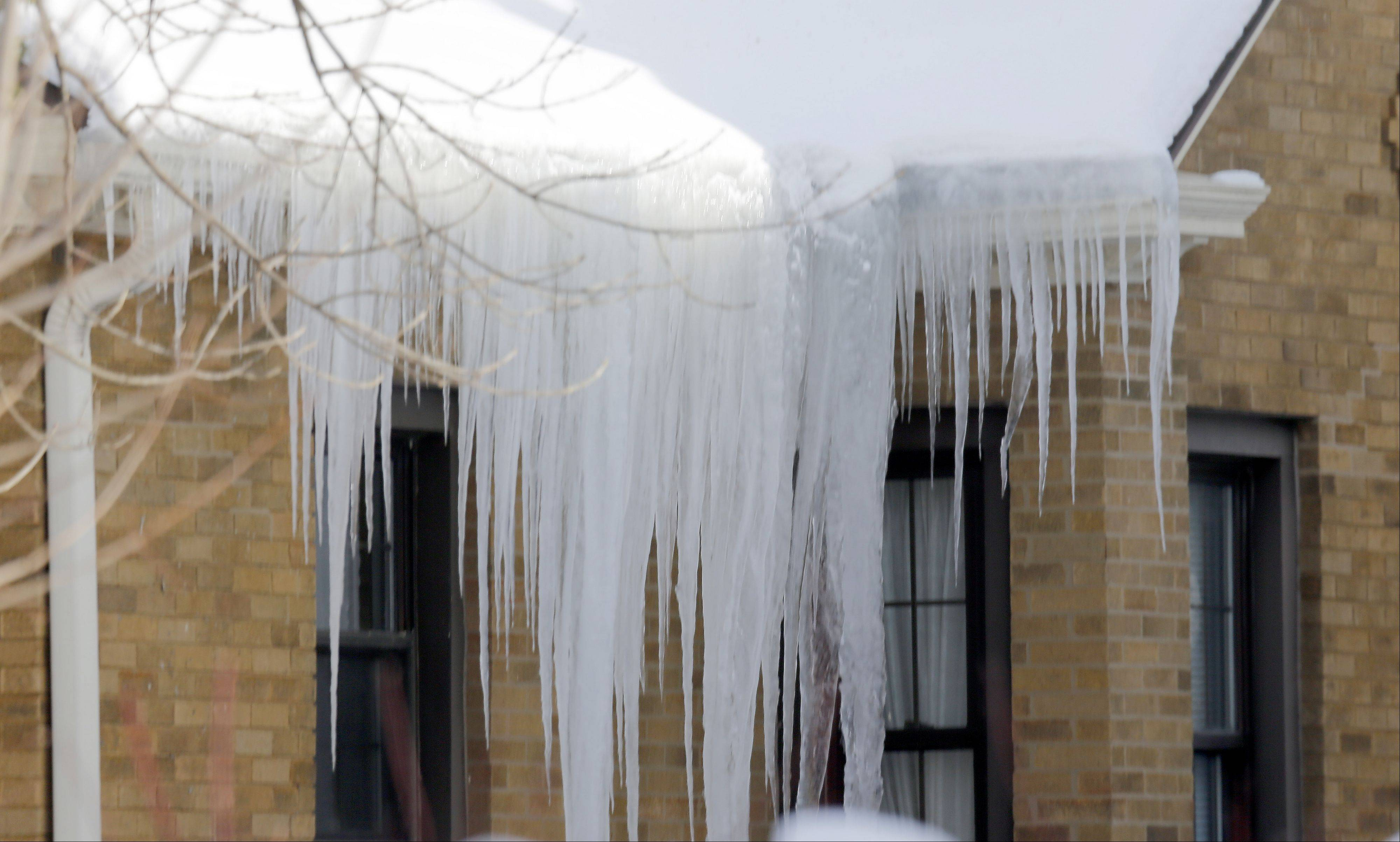 As a result of the past few days of snow and cold weather large icicles hang from homes in Elgin Wednesday.