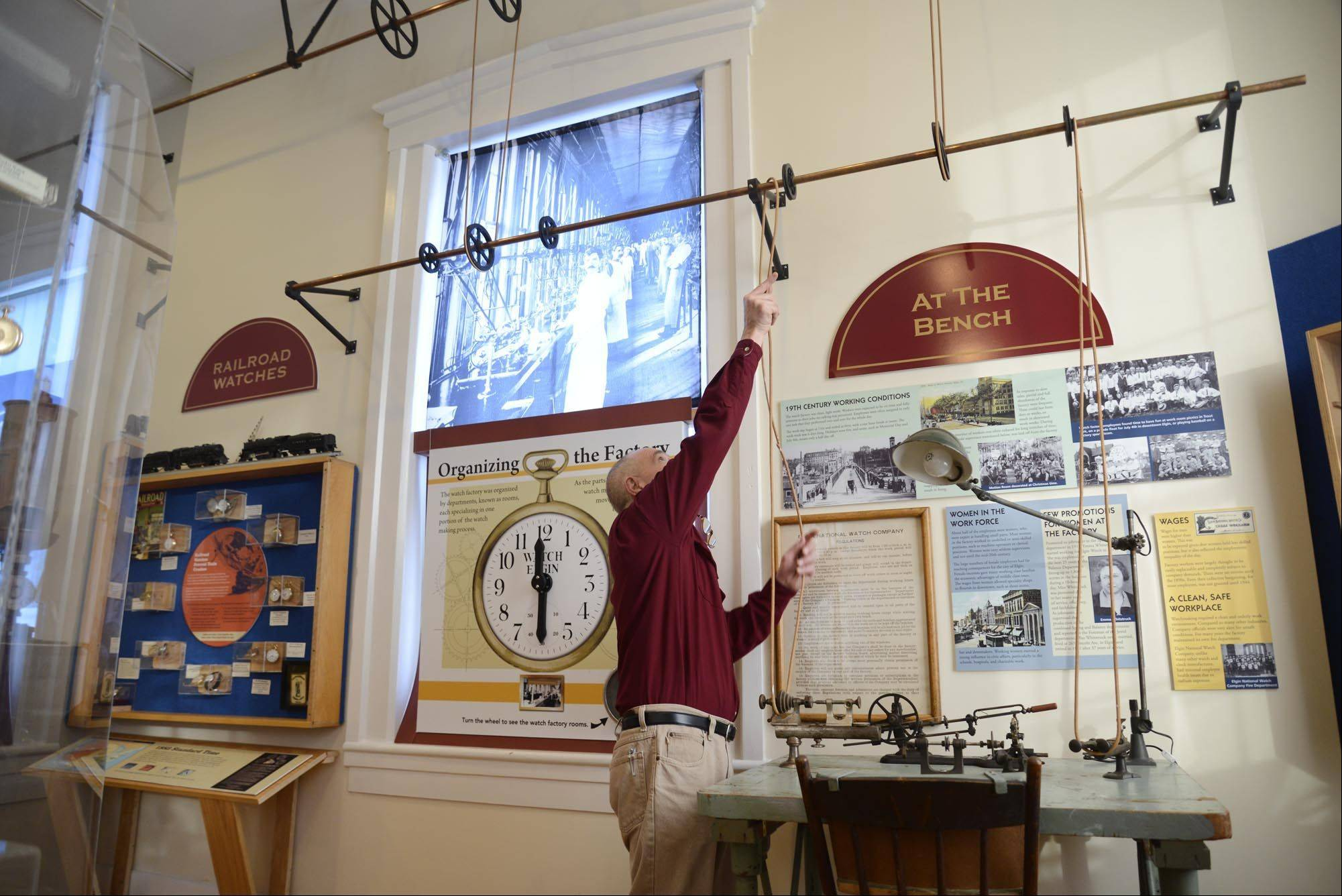 On the second floor of the museum, George Rowe adjusts an exhibit of an actual workstation used in the Elgin Watch Company nearly 100 years ago. There are more than 200 Elgin Watches on display, including the 13th and 50,000,000th made in Elgin.