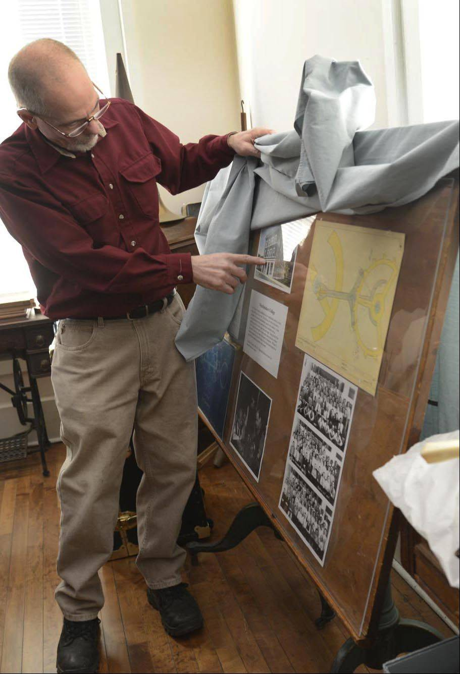 George Rowe looks at a large display of historical photos and documents on the third floor of the Elgin History Museum.