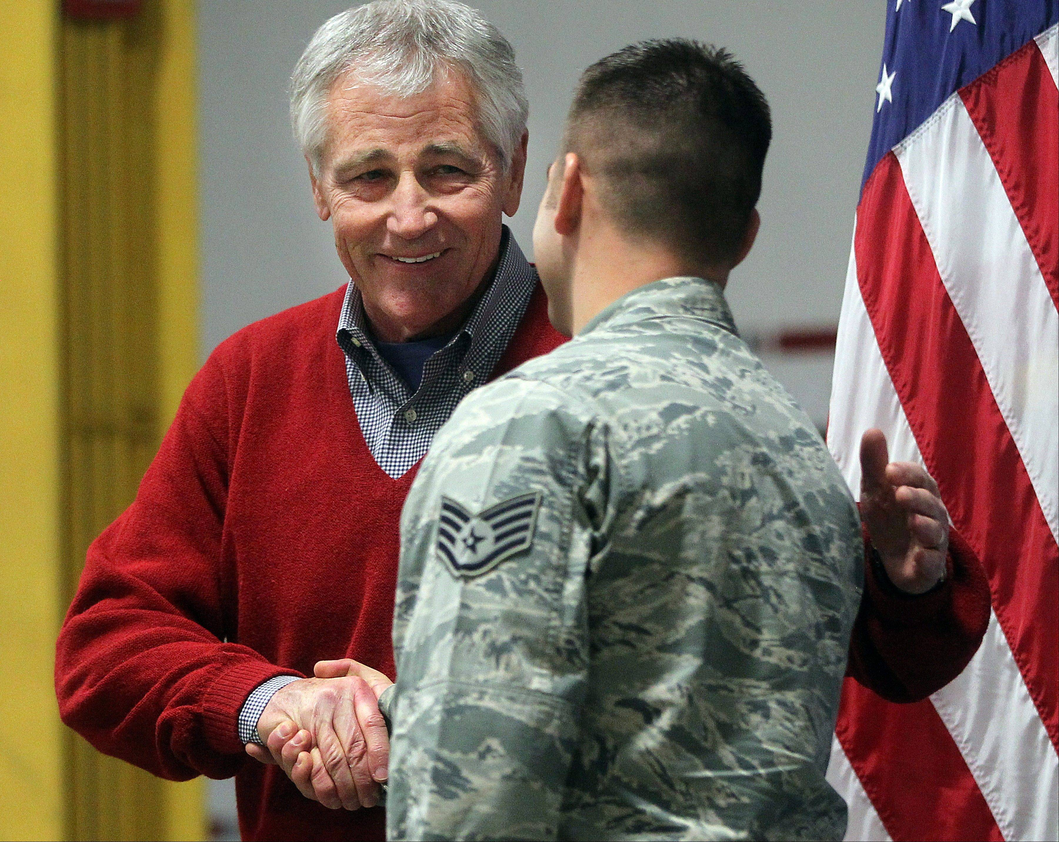 Defense Secretary Chuck Hagel greets an airman from the 20th Air Force 90th Missile Wing during a trip to F.E. Warren Air Force Base on Thursday, Jan. 9, 2014 in Cheyenne, Wyo.