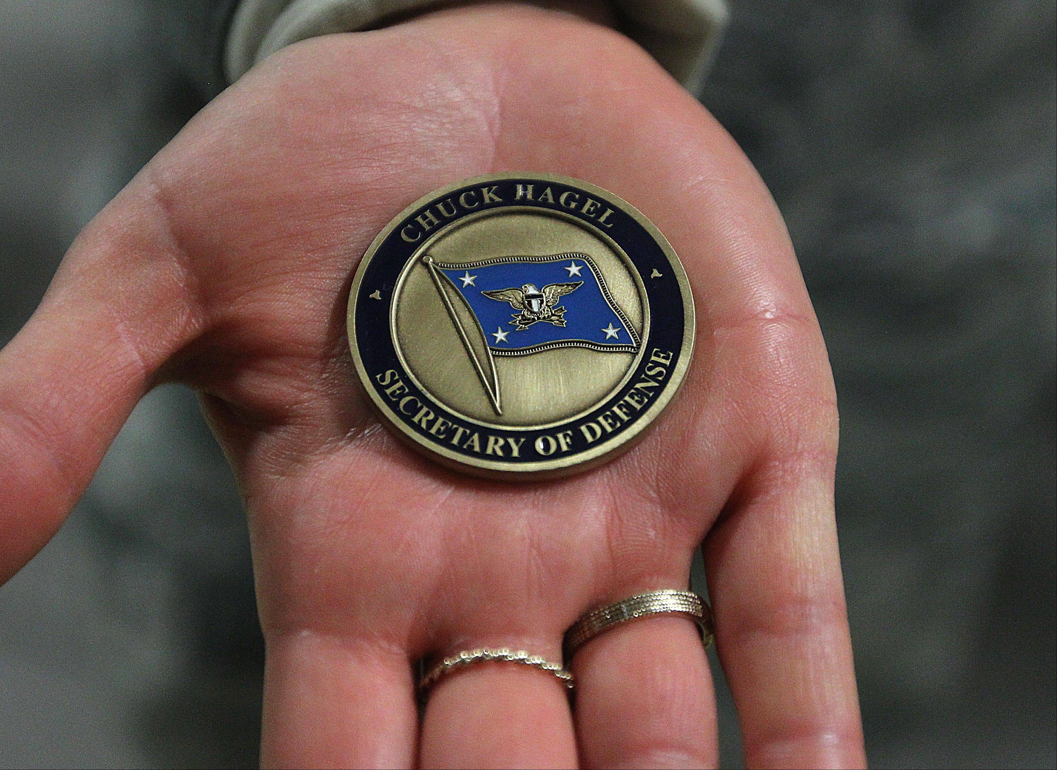 Military coins were handed out to airmen attending the visit of Defense Secretary Chuck Hagel on Thursday, Jan. 9, 2014 at F.E. Warren Air Force Base in Cheyenne, Wyo.