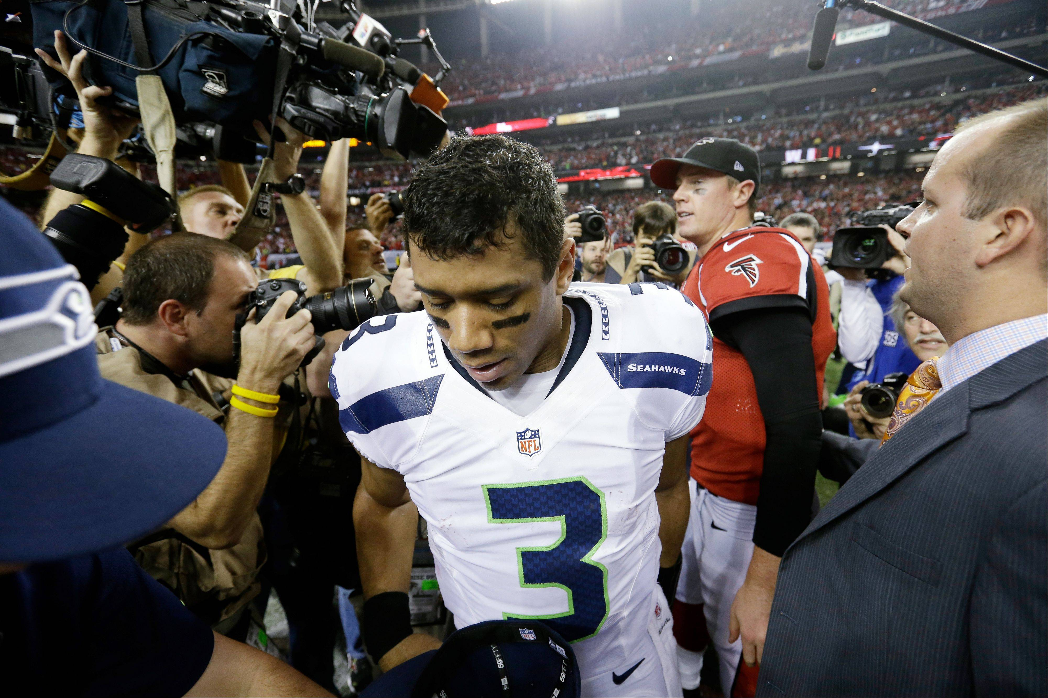 Seattle Seahawks quarterback Russell Wilson leaves the field after last year's loss to Atlanta in the playoffs.